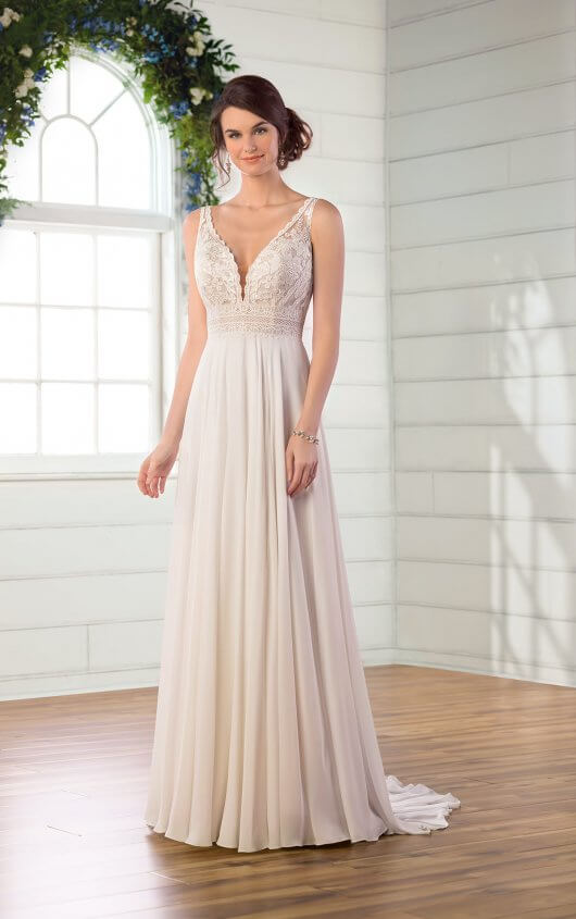 D2971 -  Bohemian-inspired beauties, meet your perfect match with this sheath wedding dress! Unique laces are layered throughout the bodice to trim the waistline and flatter the shape, while a softly curved V-neckline adds a bit of classic femininity to this laid-back silhouette. Wide lace straps form the open V-back with a scalloped finish for a traditional bridal look that shows a bit of skin—perfectly complementing the breezy crepe chiffon skirt that is enviably soft. This perfectly beachy-boho wedding dress is also available in plus sizes, and zips beneath fabric-covered buttons.  Available in: Ivory, White