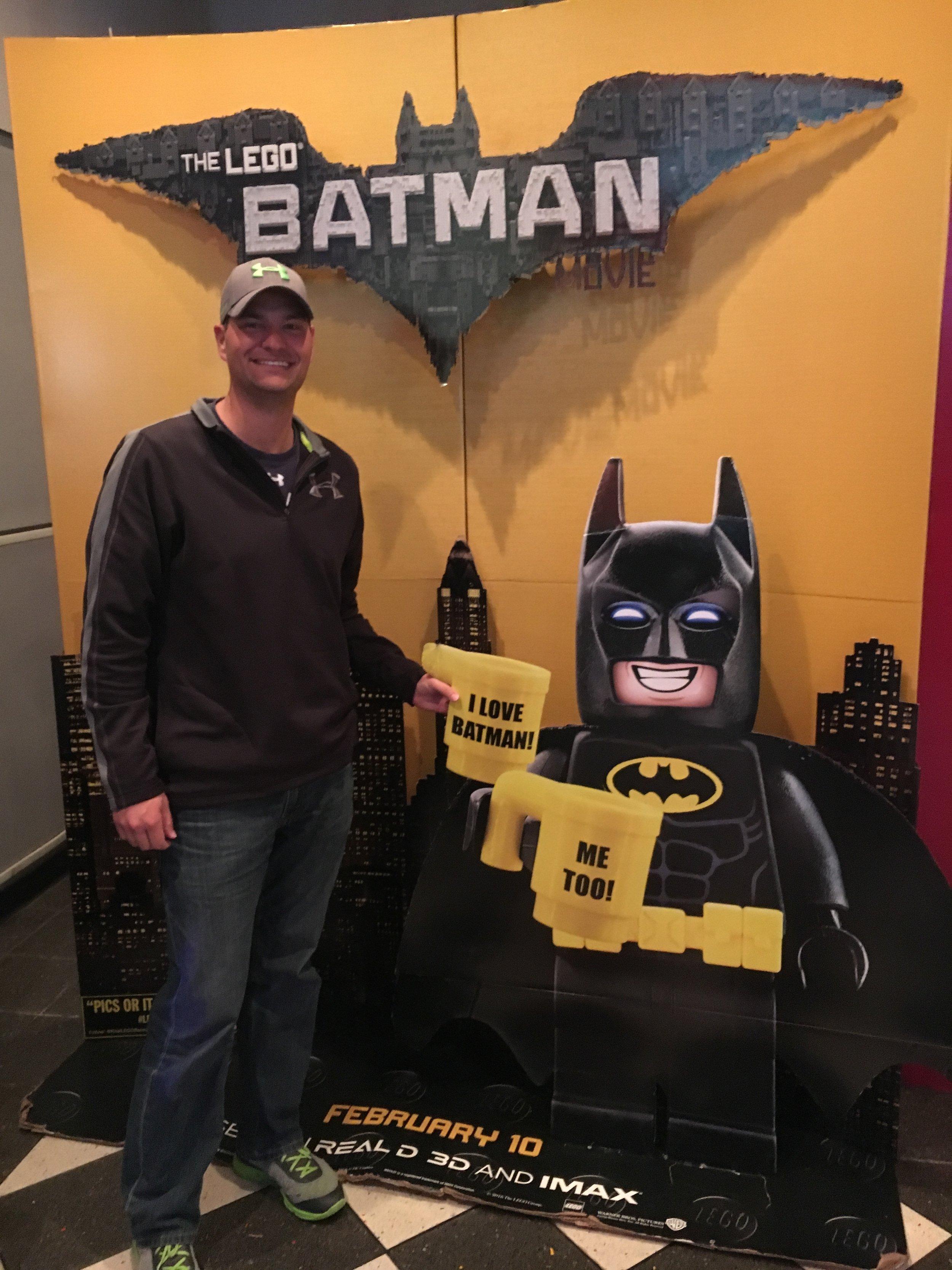 Andrew having a toast with LEGO Batman.