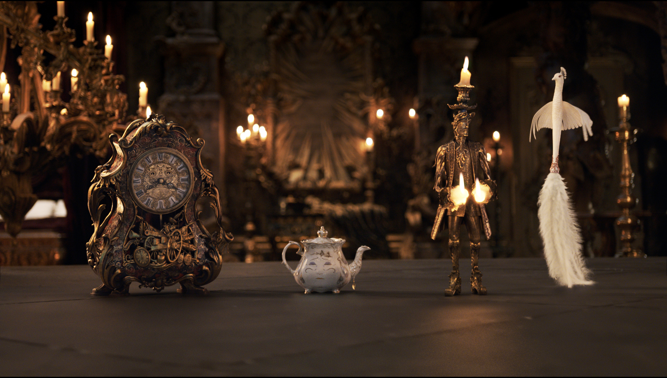 Check out the cool reimagination of the household objects: Cogsworth (McKellen), Mrs. Potts (Thompson), Lumiere (McGregor) and Plumette (Mbatha-Raw).