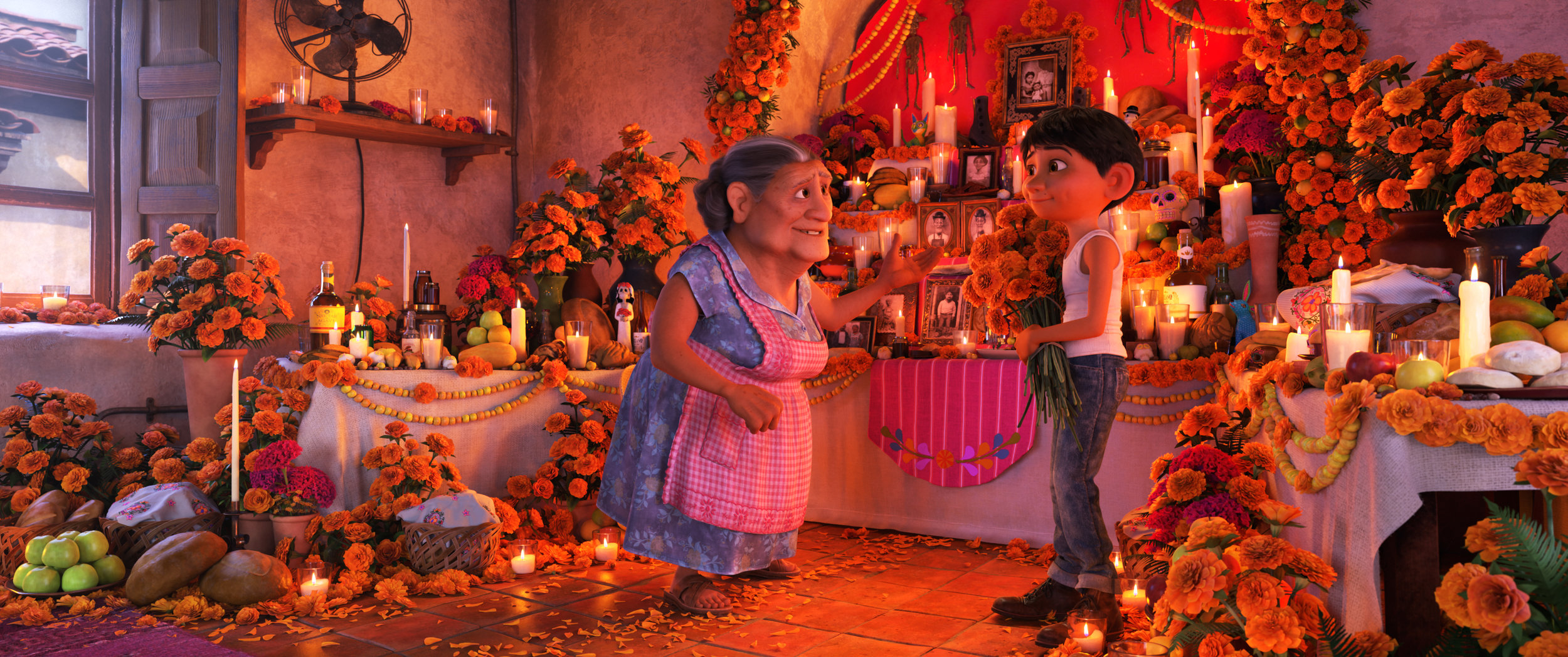 Miguel with his Grandmother at the ofrenda