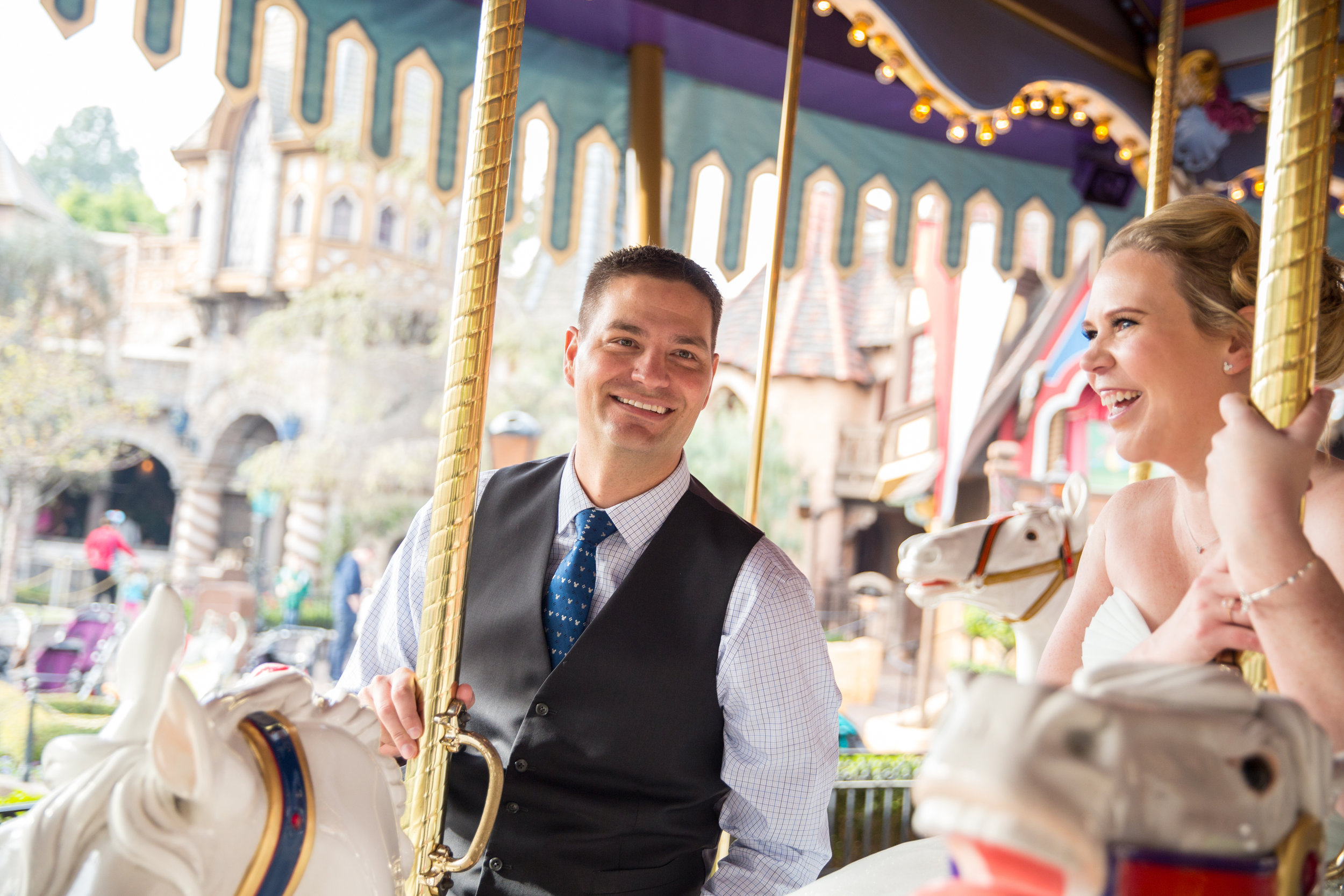 Riding a carousel horse in formal wear is harder than it looks!