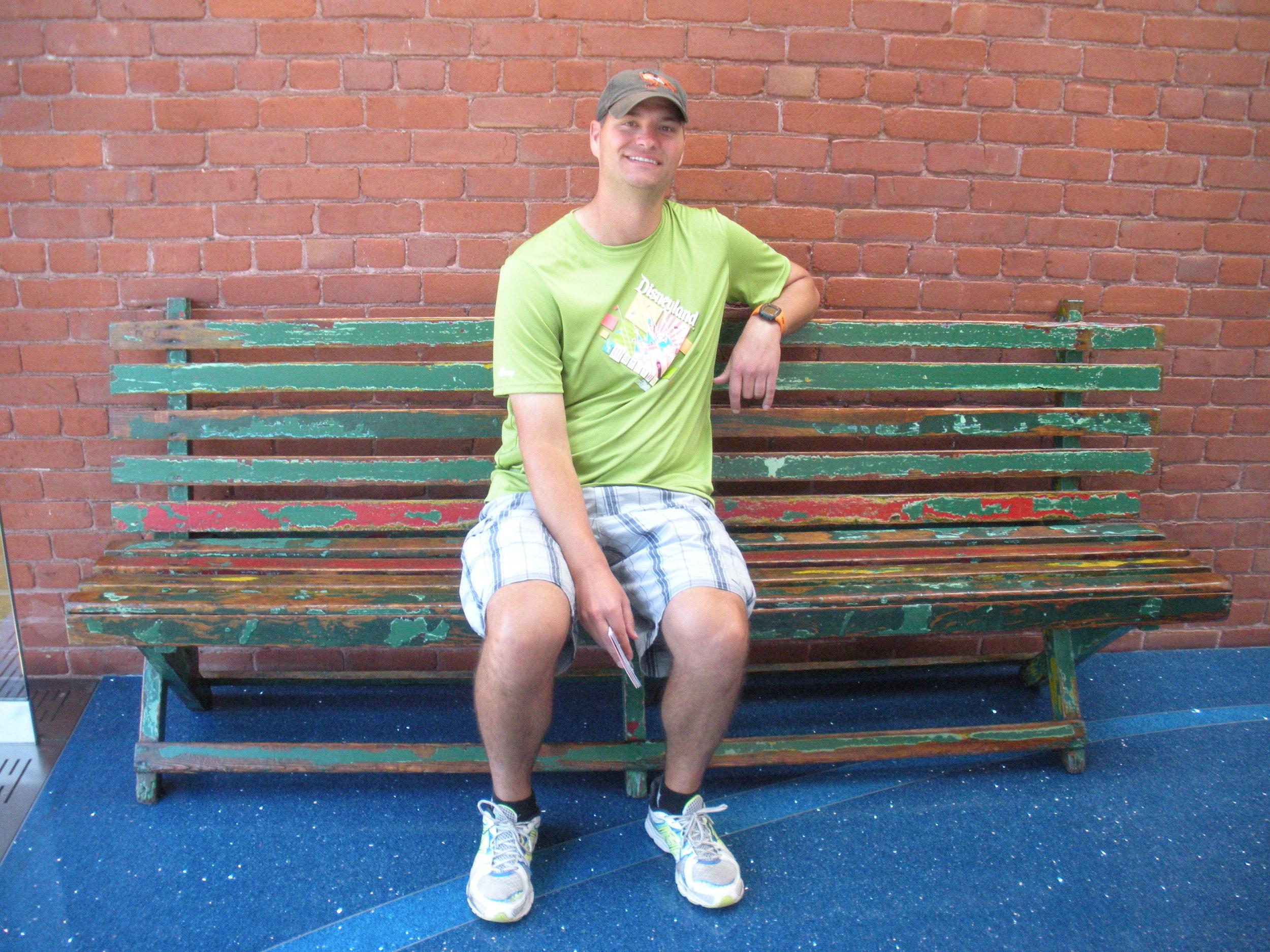 Andrew sitting on Walt's bench.