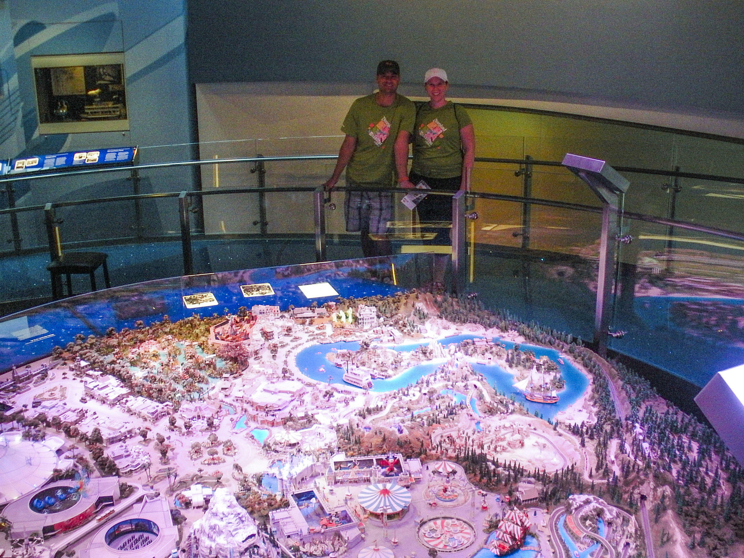 Us with a huge map of Disneyland. (please excuse our grainy pic, the museum lighting was not the best for photos!)