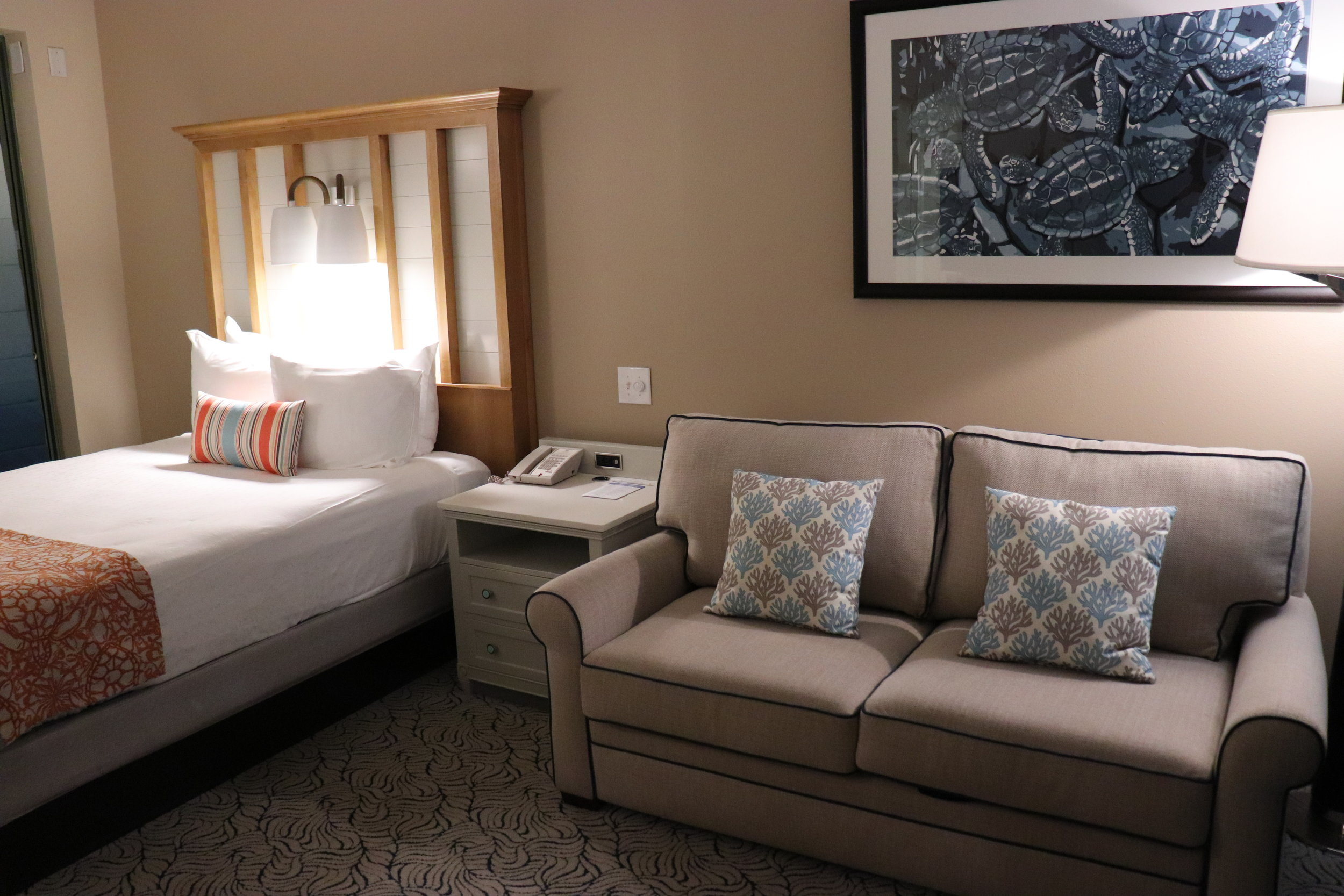 A Deluxe Studio features a bed and pull out sofa.