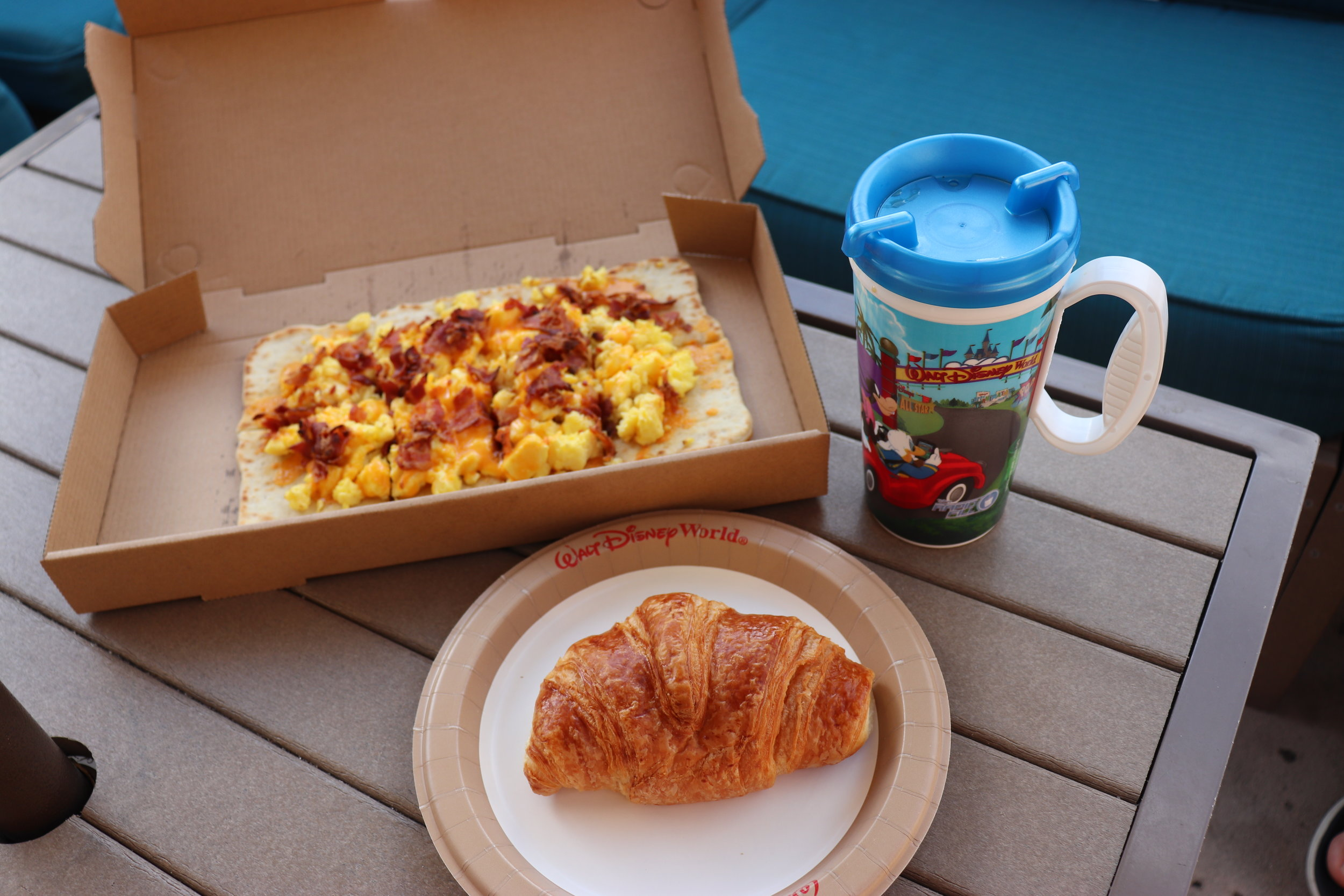 Breakfast flatbread, croissant and refillable coffee.