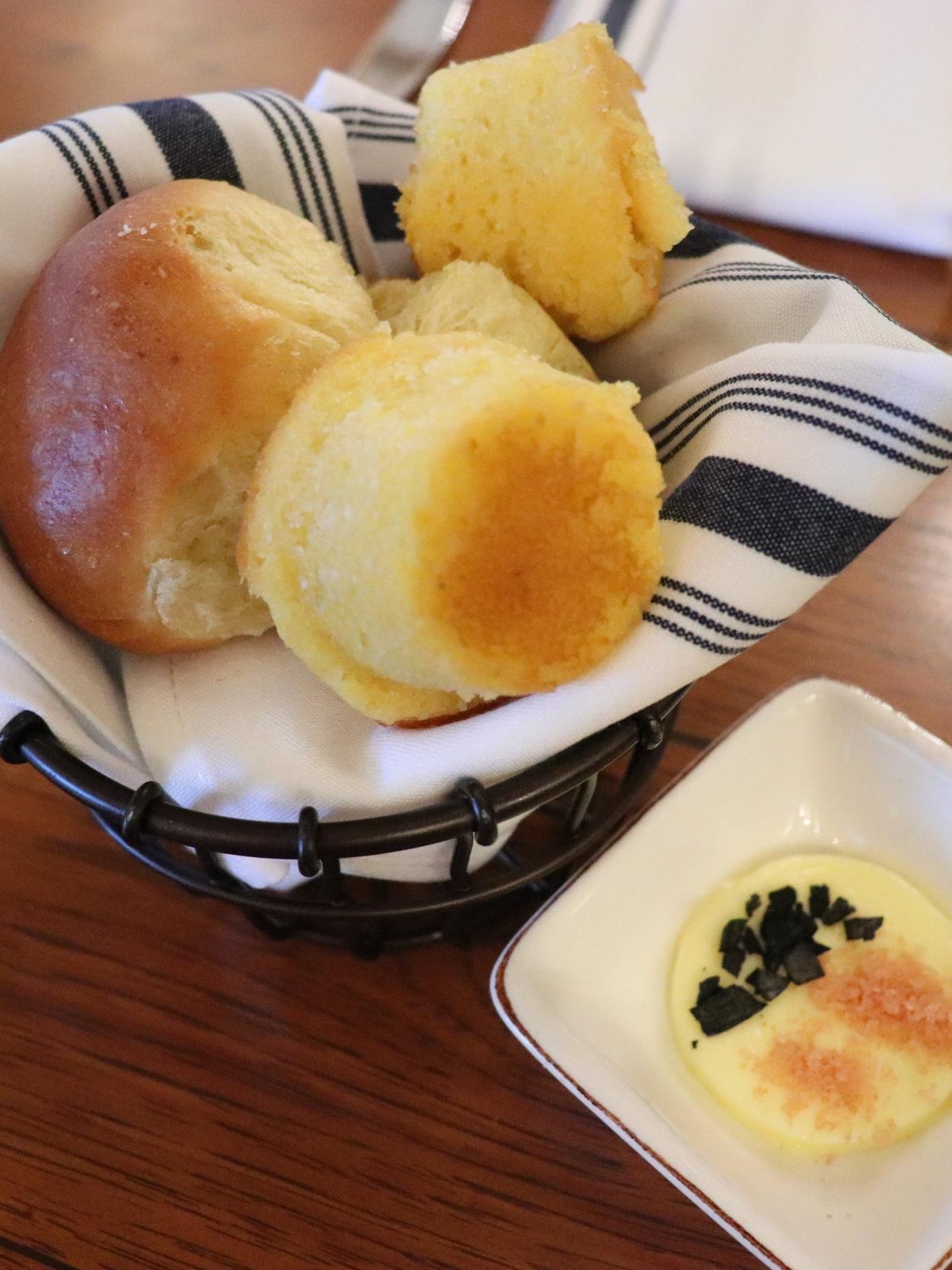 Bread service: cornbread and Hawaiian rolls.