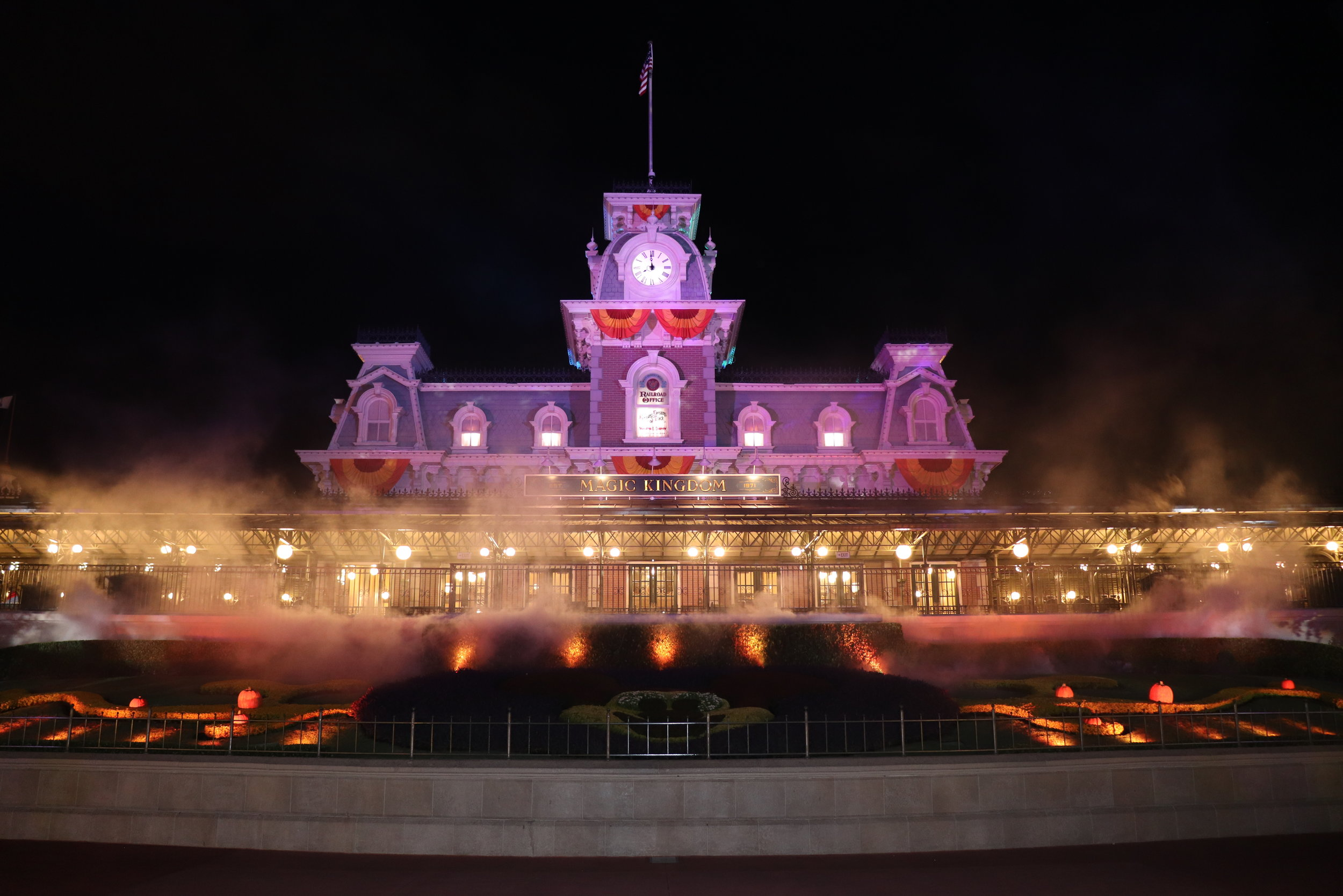 The Main Street Train Station looks particularly eerie with the fog and orange lighting.