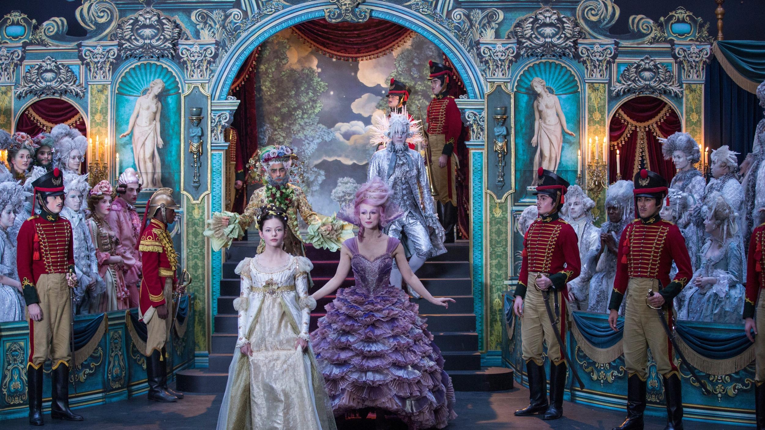Clara being introduced at a reception by Sugar Plum (Knightley), Hawthorne (Derbez), and Shiver (Grant).