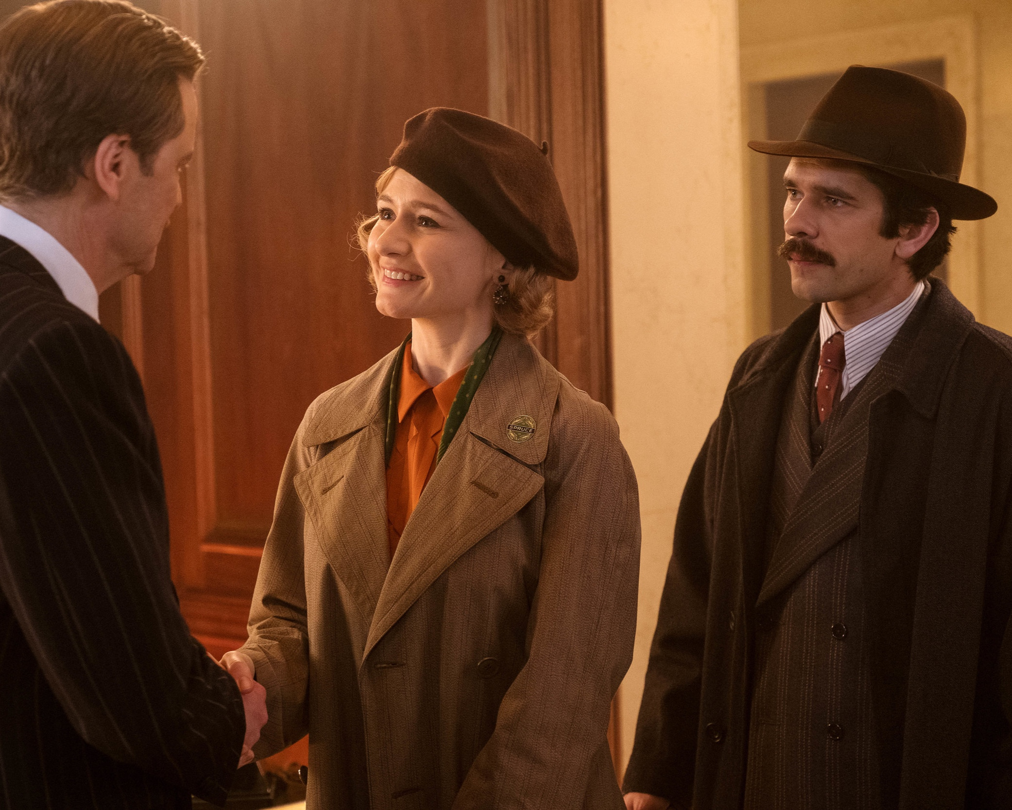Grown up Jane (Mortimer) & Michael (Whishaw) Banks with banker Wilkins (Firth).