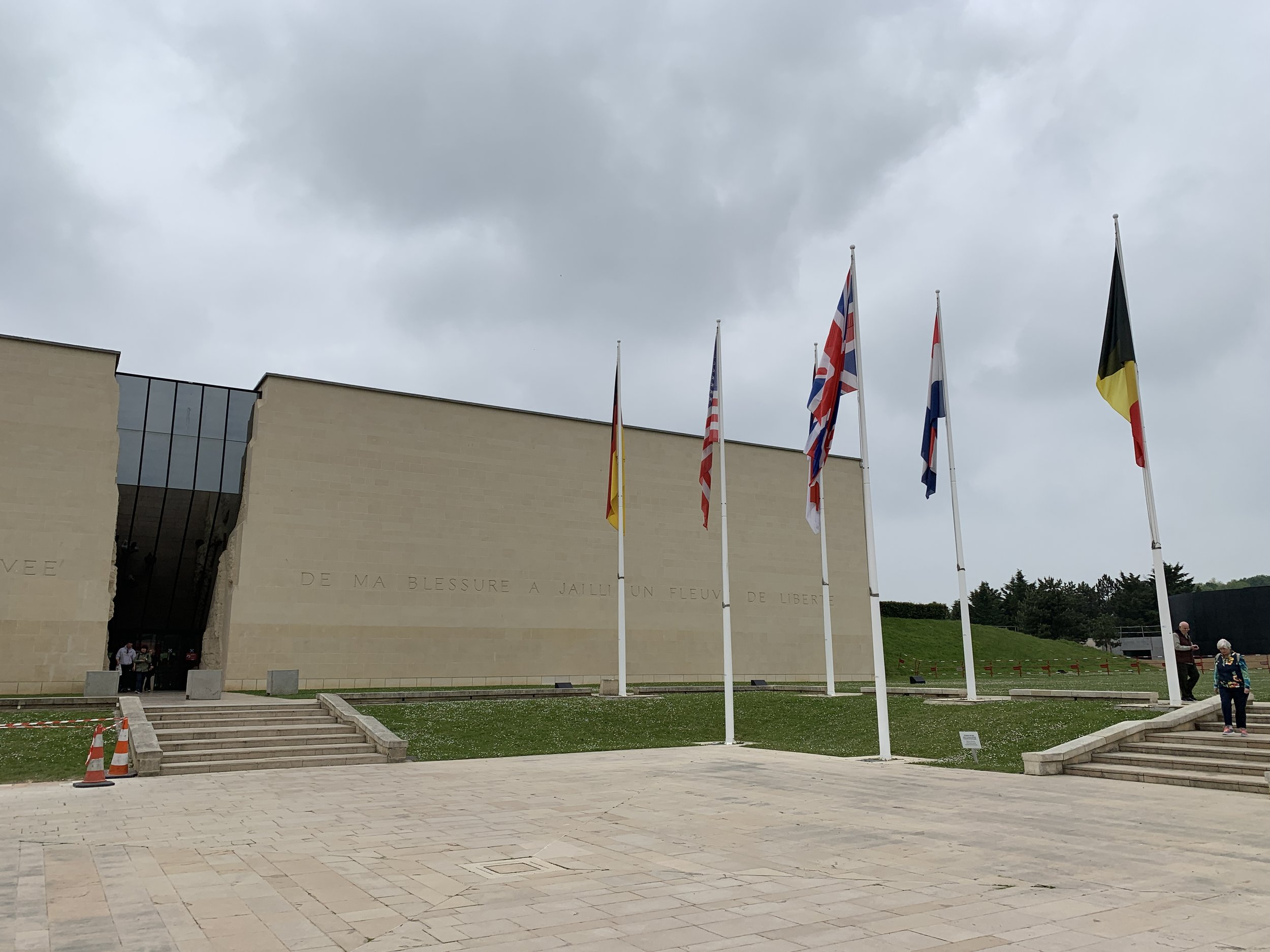 The flags outside represent the countries involved.