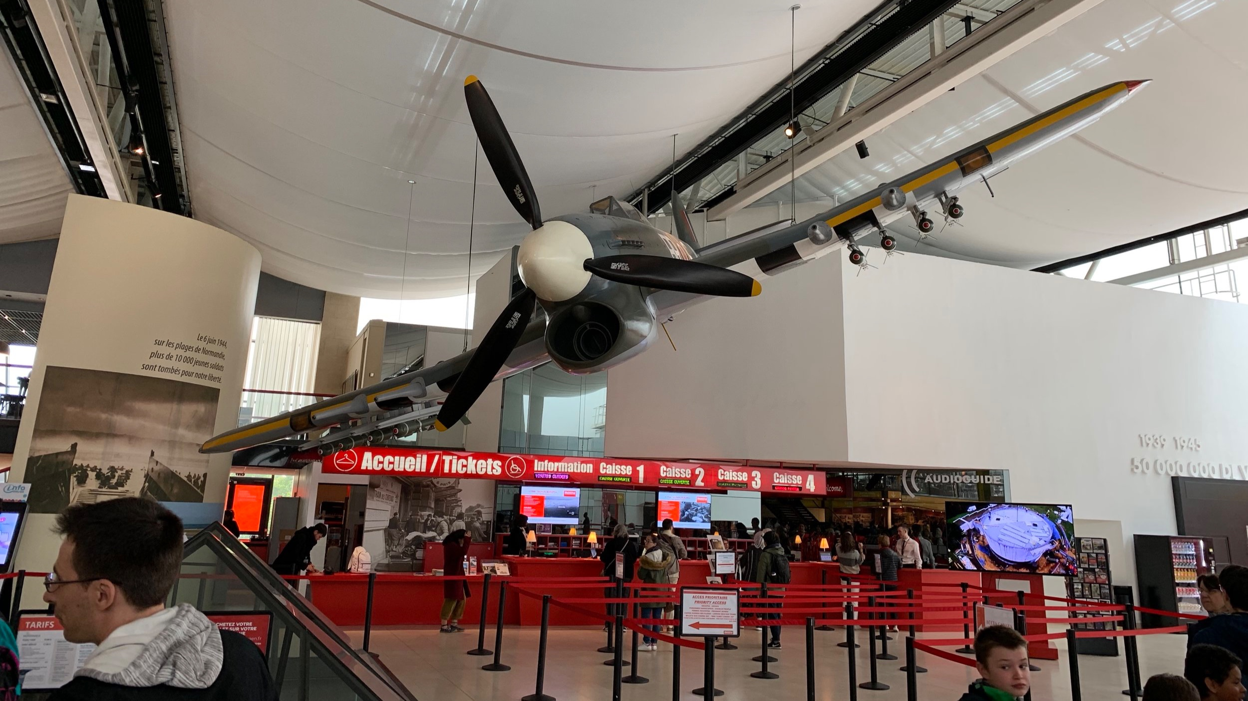 The main lobby of the museum featured a war plane suspended from the ceiling.