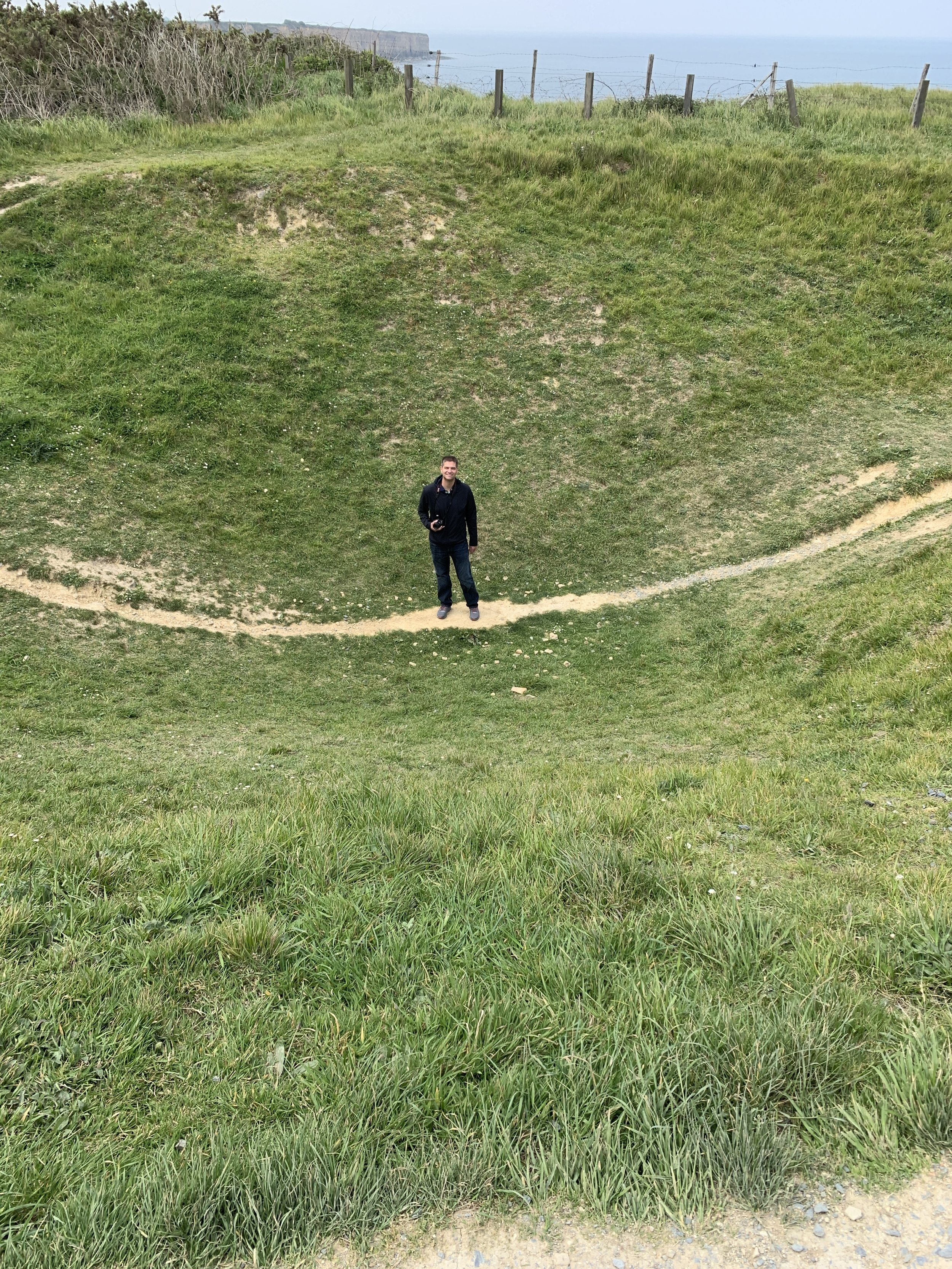 Andrew exploring one of the bomb craters.