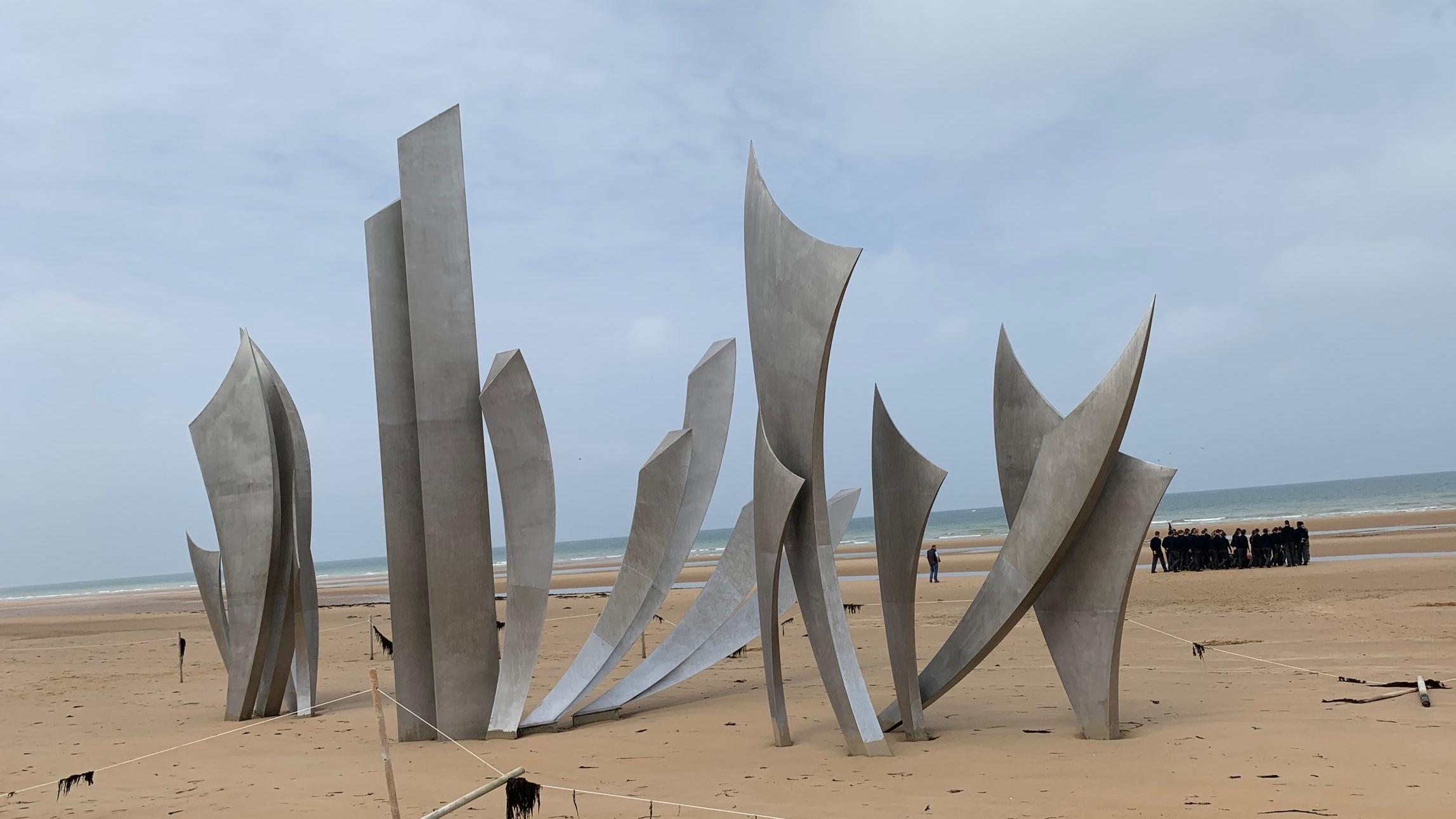 The memorial in front of the ocean.
