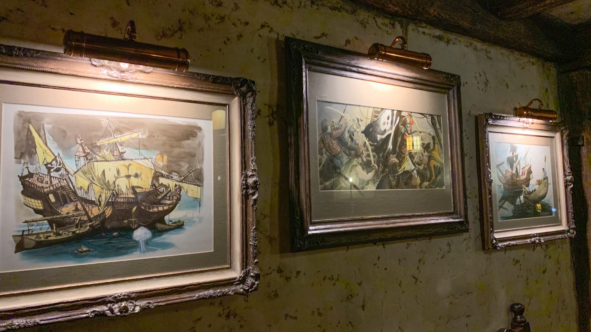 Vintage ride artwork in ornate frames.