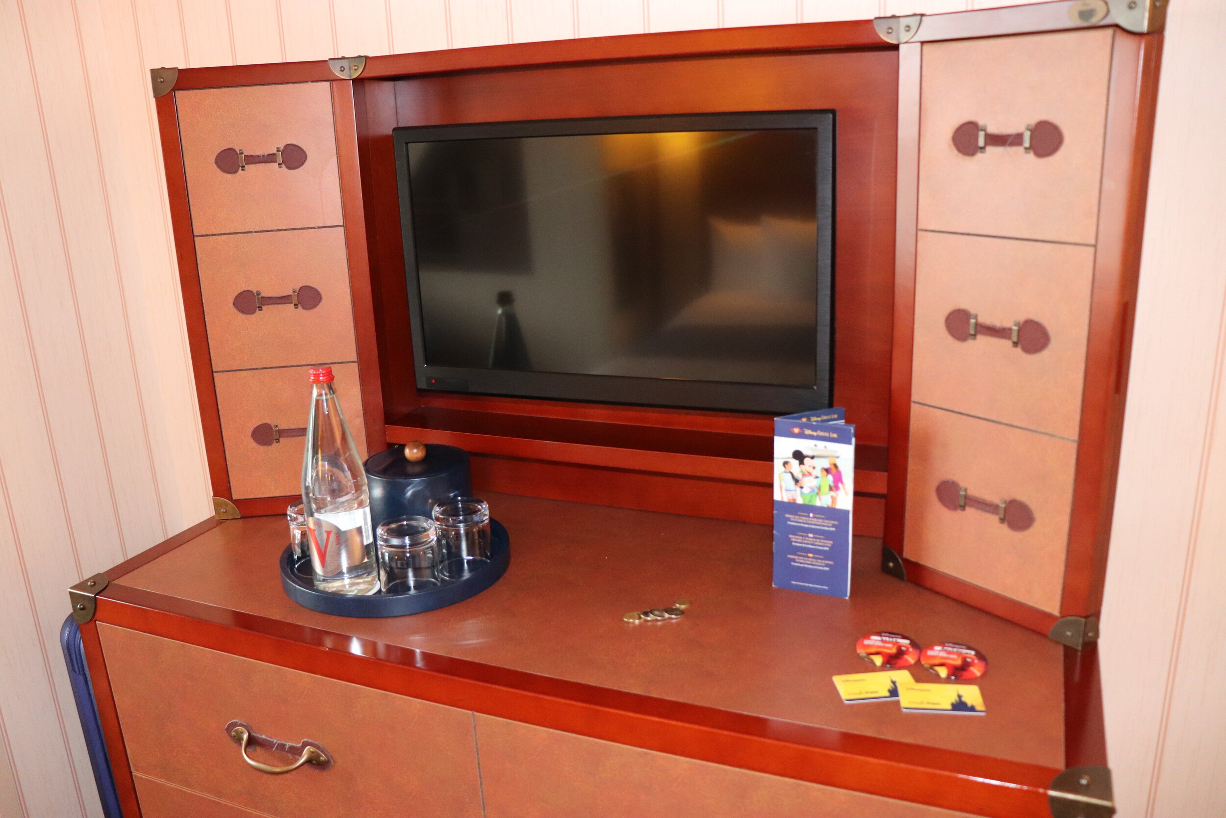 The dresser looked like a steamer trunk and had extra shelves on the sides of the TV.