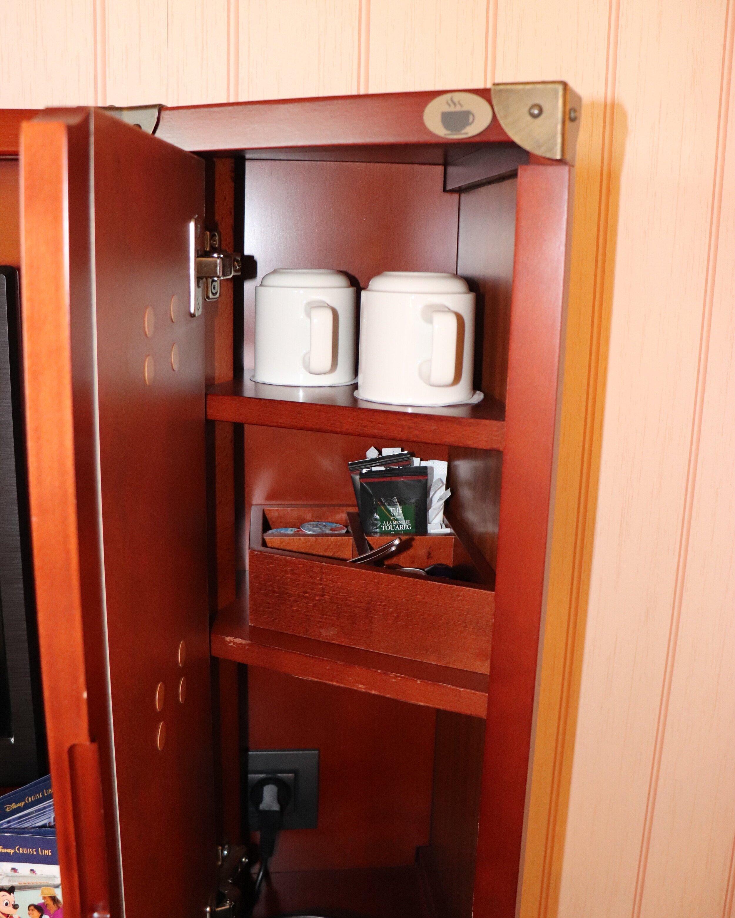 Tea supplies in the dresser.