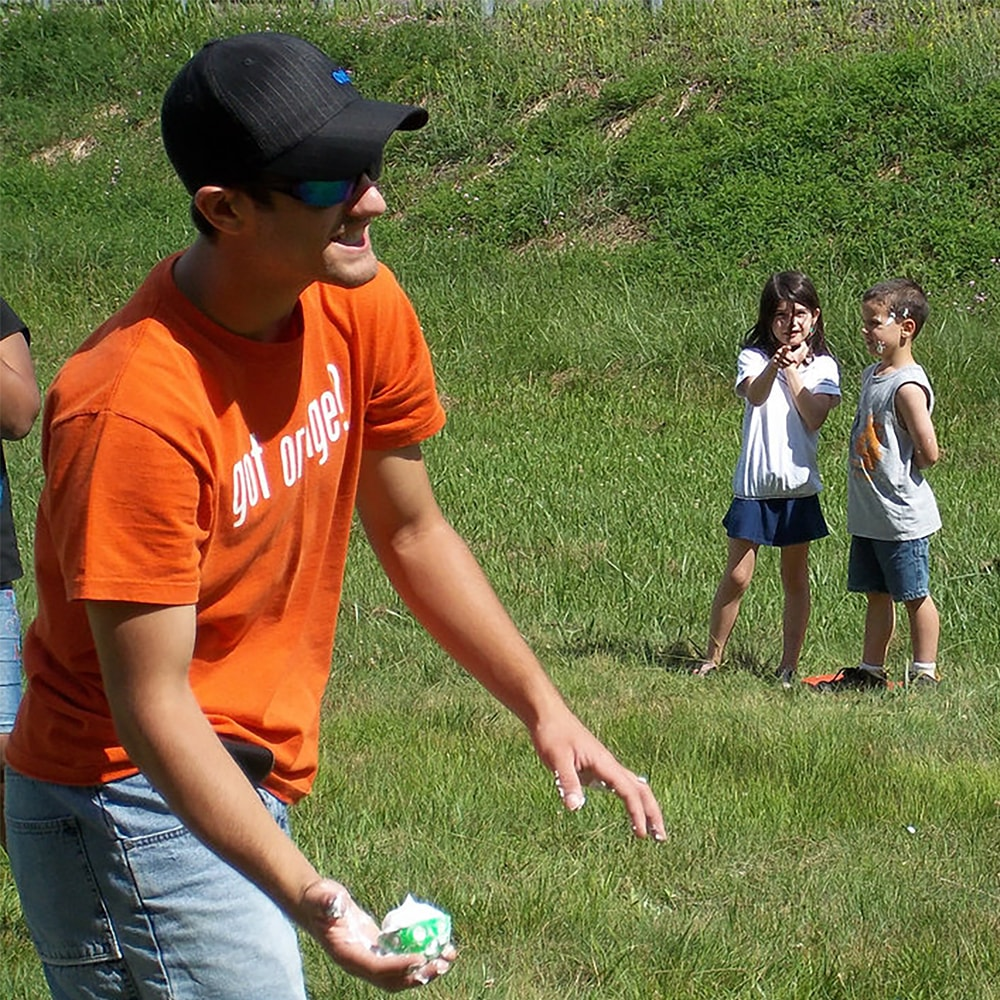 Summer 2010: Kyle playing shaving cream wiffle ball with junior week campers