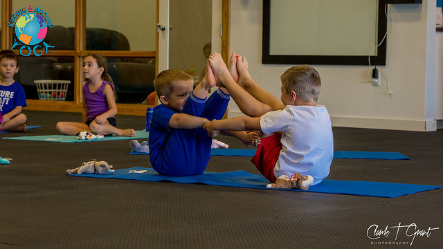 Kids doing yoga poses together. (C)Kidding Around Yoga