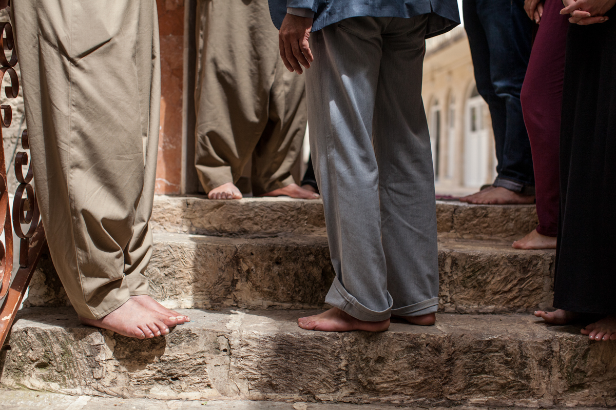 Bare feet at Lalish holy temple of the Yazidi people in Dohuk, Iraq. All visitors and residents are required to take off their shoes at the entrance to the village (April 2016).