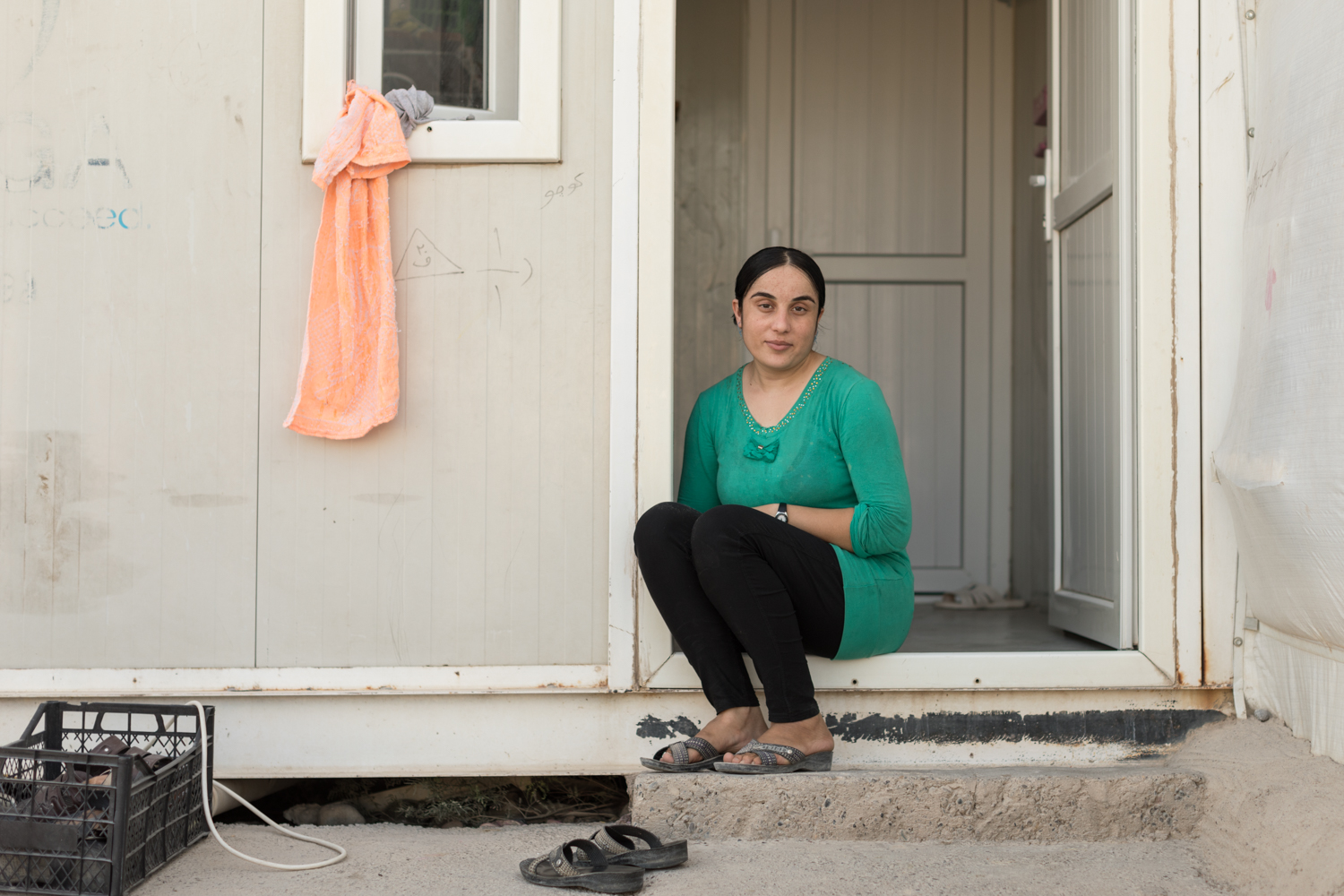 Nofa, a 24-year-old Yazidi woman who survived weeks living as an ISIS sex slave, sits outside her shelter at the 19,000 member Rwanga Community Camp in Qadiya, Iraq. hot for Grazia Magazine UK (August 2017).