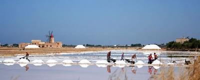 Salt workers in the Trapani Salt fields harvesting Sea Salt