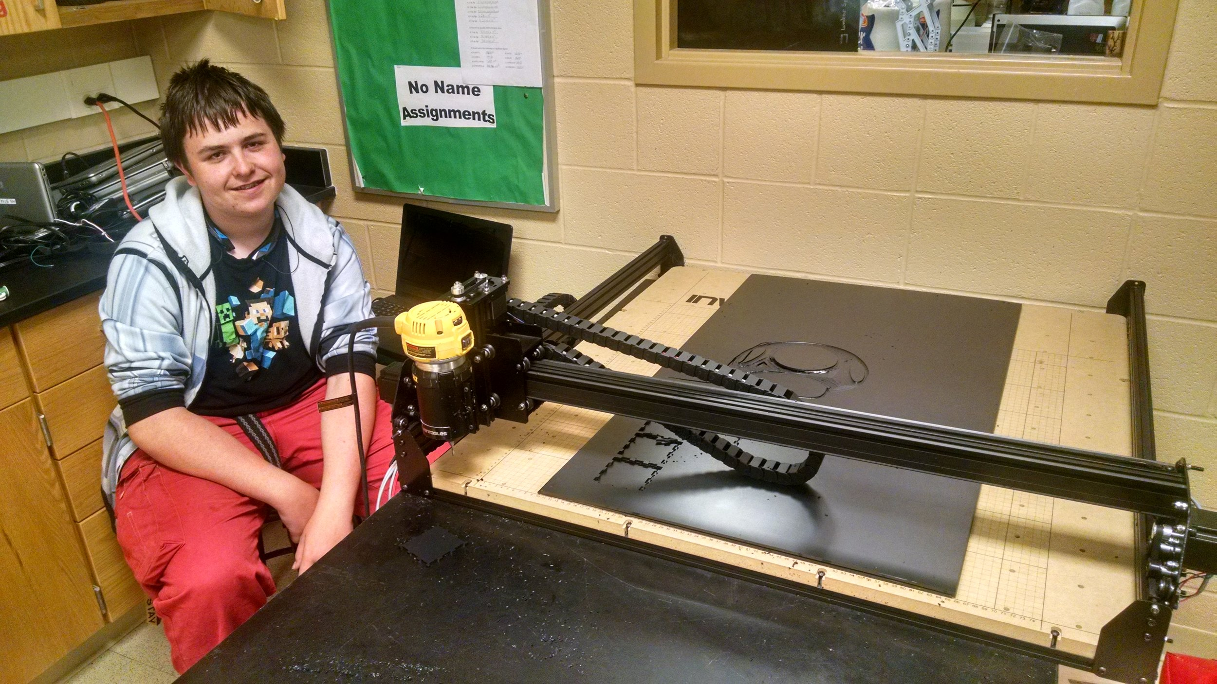 Dagan Kuhn sitting next to the completed X-Carve.