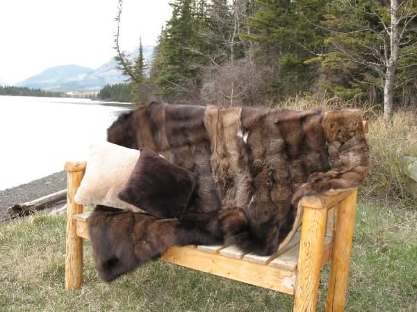 fisher blanket, white sheared beaver pillow, dark sheared beaver pillow.jpg