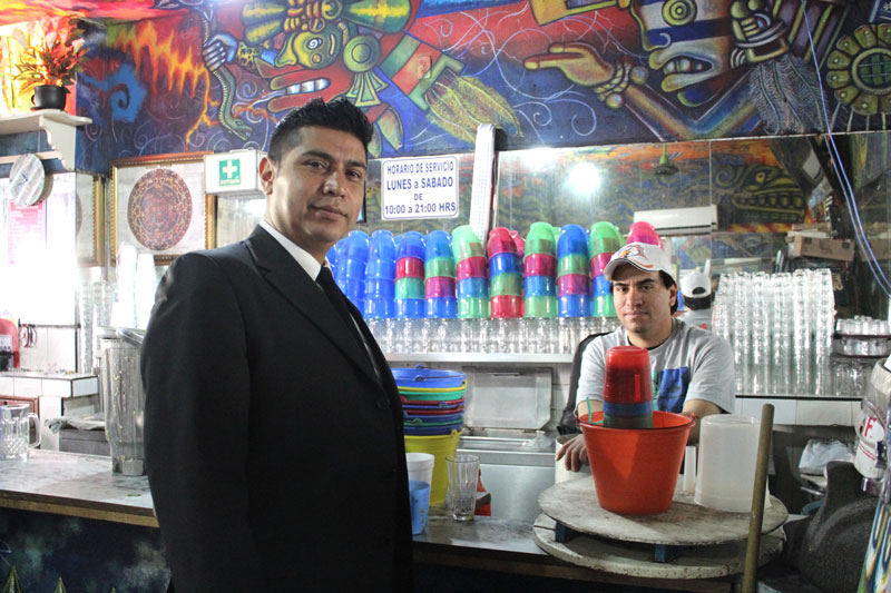 Above: Cesar and the bartender, taken after we negotiated and gained permission to use our table to draw while we drink pulque.