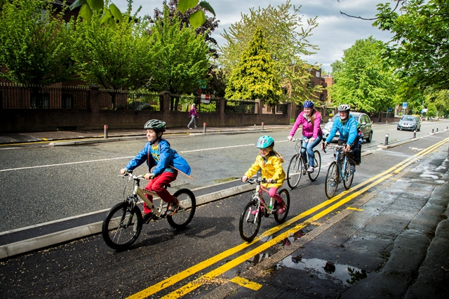 Family_cycling_along_the_Wilmslow_Road_Cycleway__002_.jpg