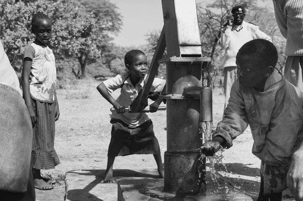 We arrived at the water pump. The children quickly began pumping water and demonstrating how the newly installed pump worked.