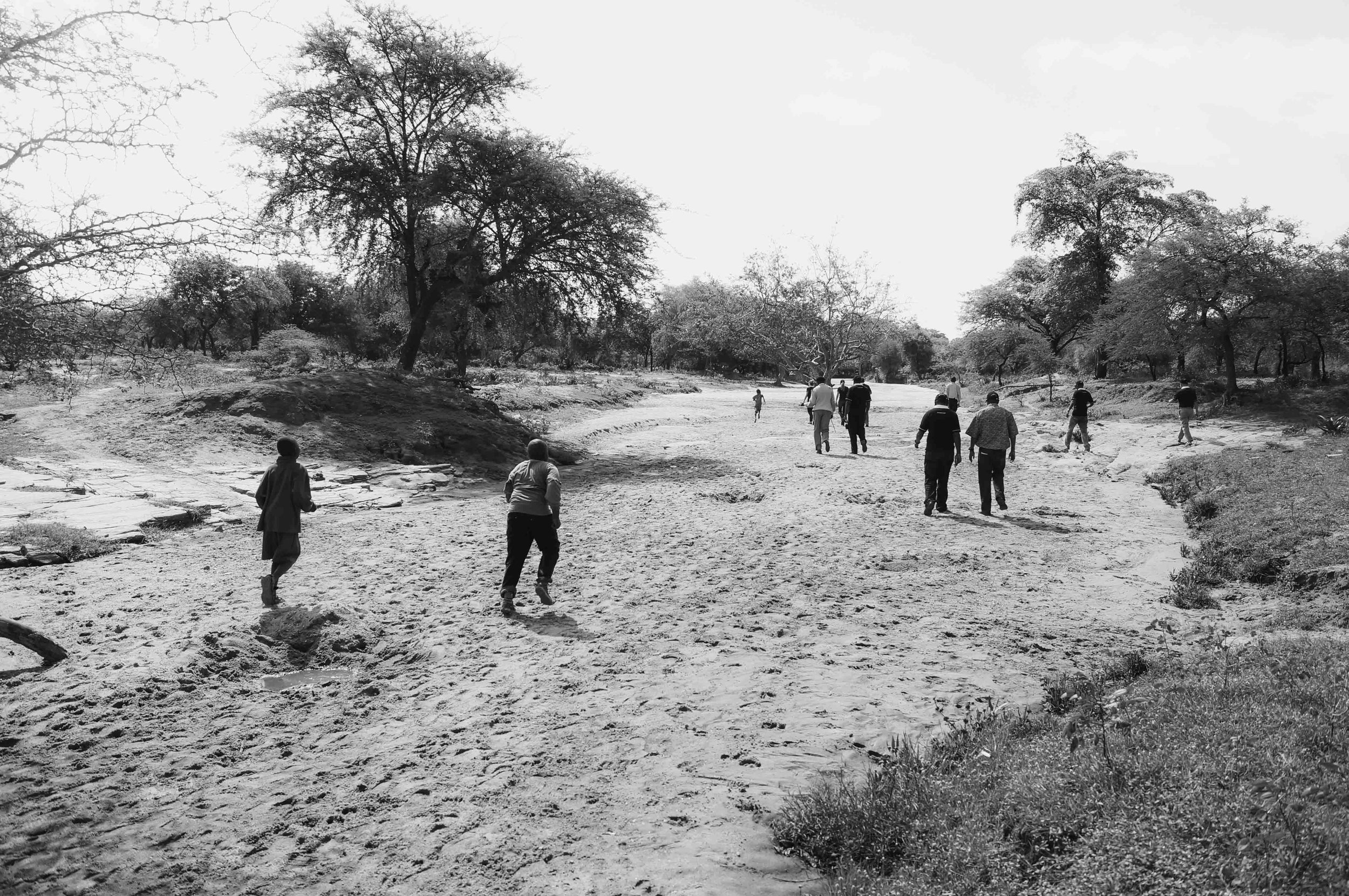 The locals welcomed us and lead us from the village along the barren river bed which was once a source of water.