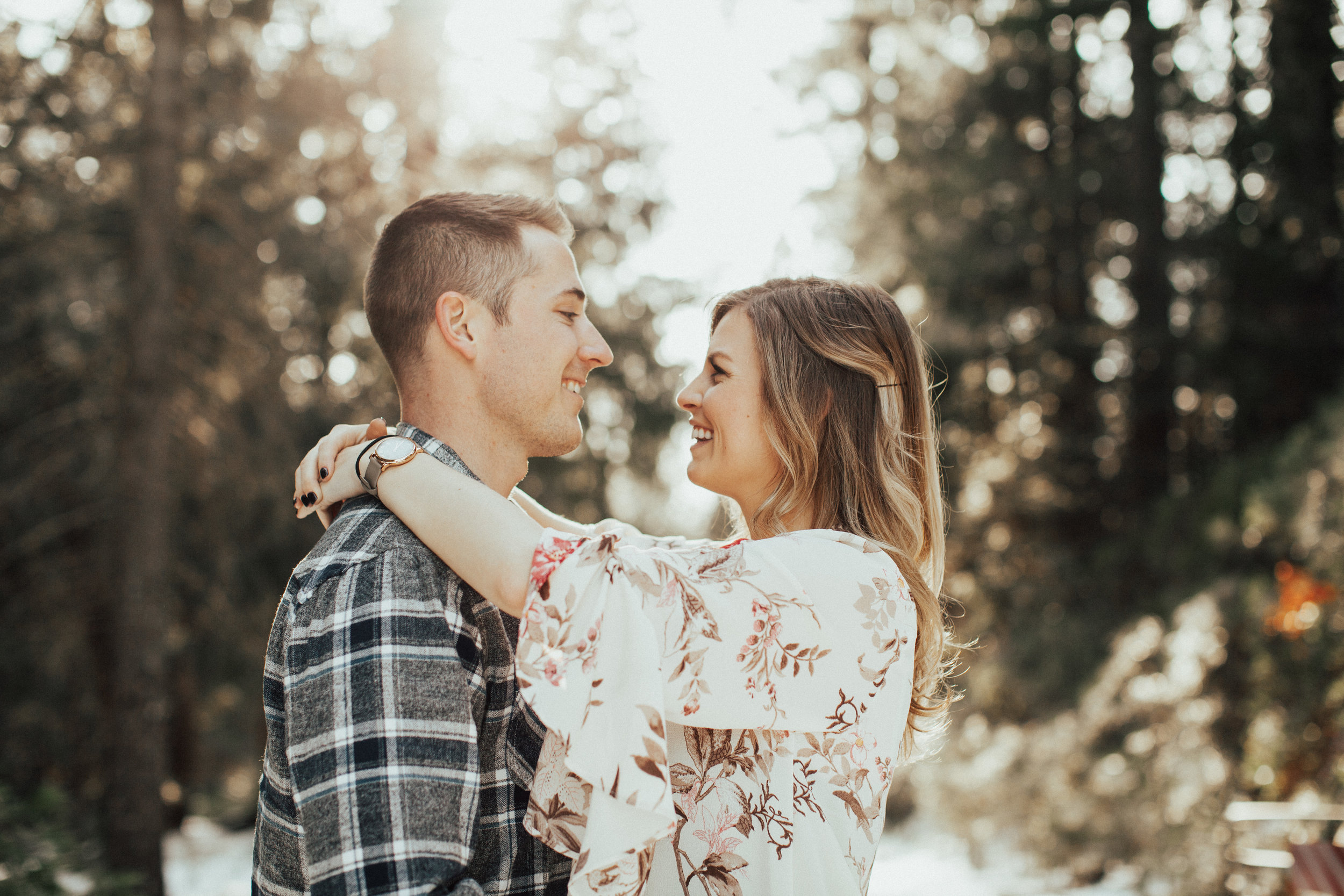 Couple in love about to kiss in front of the snowy nevada city roads.