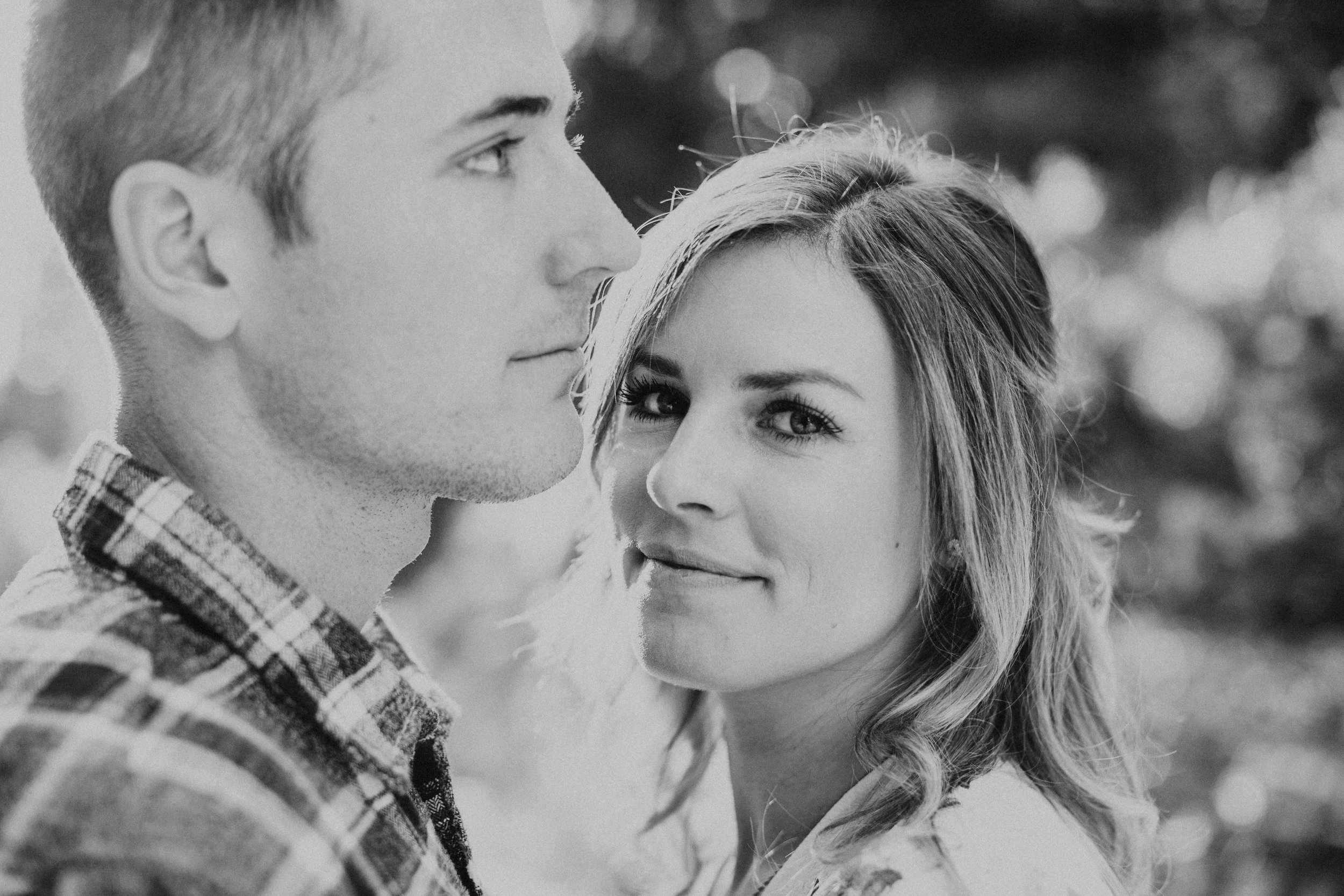 Black and white photo from an adventurous couples session in Nevada City.