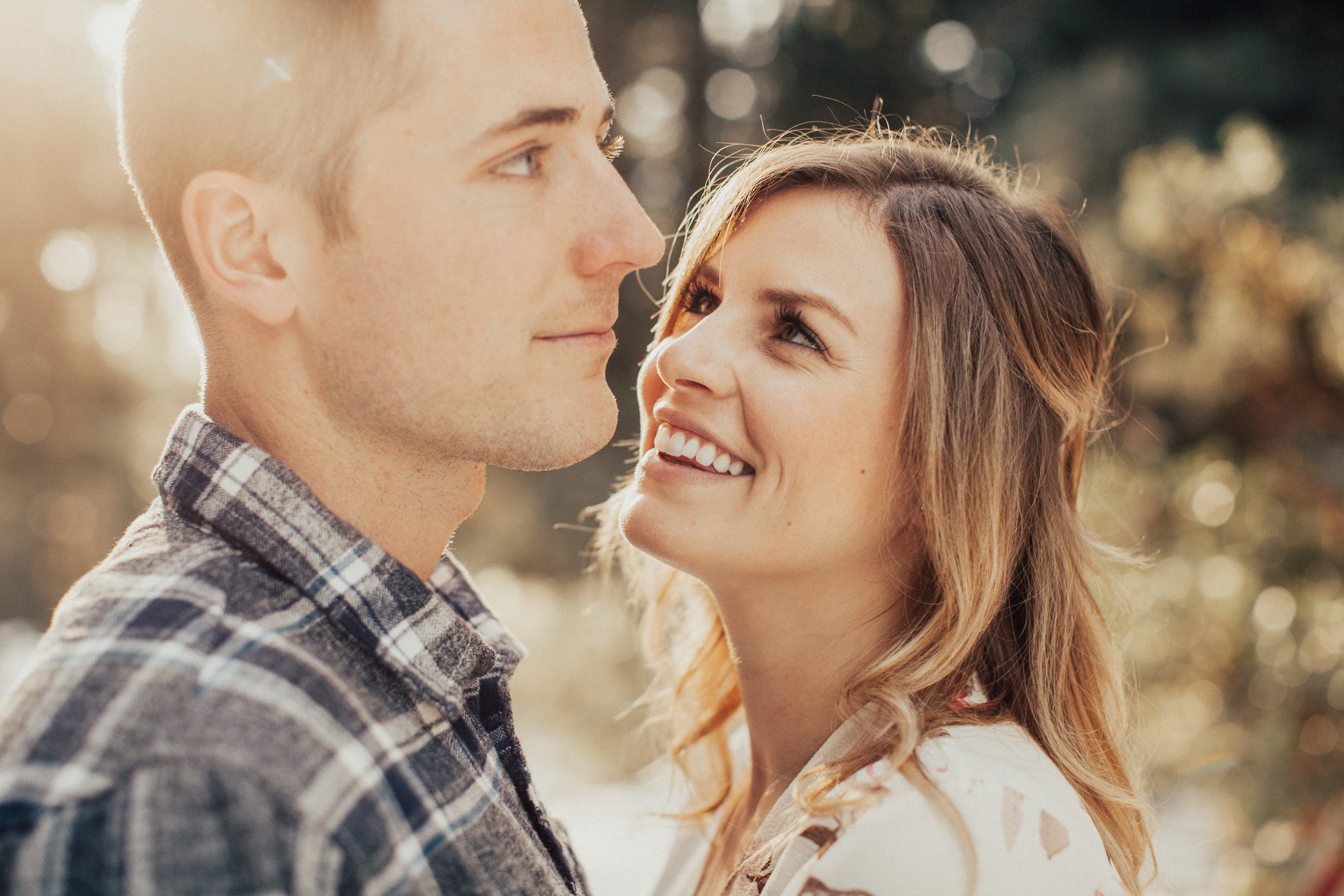 Girl smiling looking lovingly at her boyfriend.