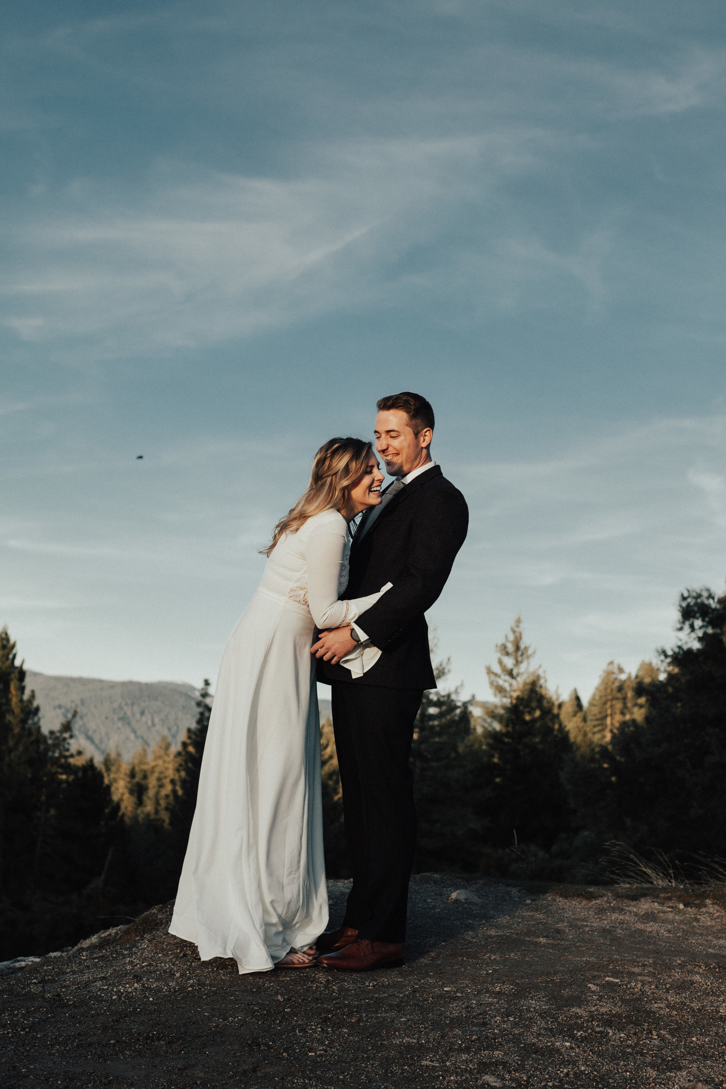 Bride and groom laughing together. They have just eloped and are estatic to spend the rest of their lives together!