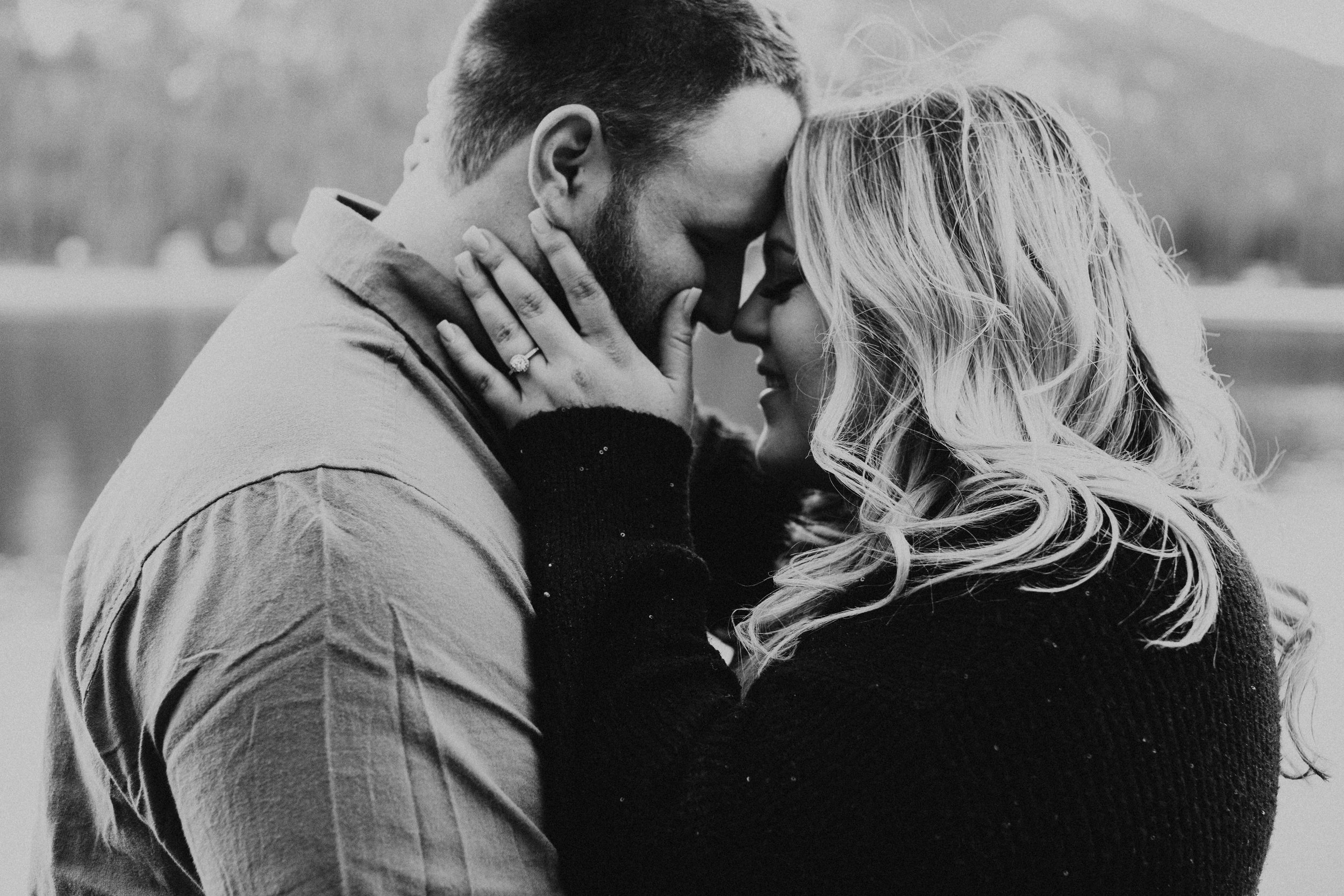 Couple snuggled up together for their engagement photos!