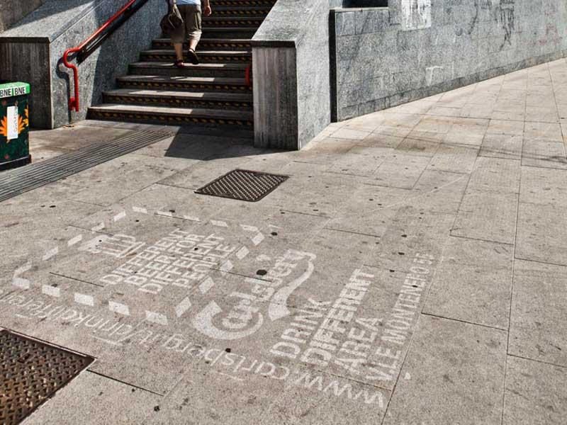 calrsberg-outdoor-promotion-reverse-graffiti-cleaned-advertising.jpg