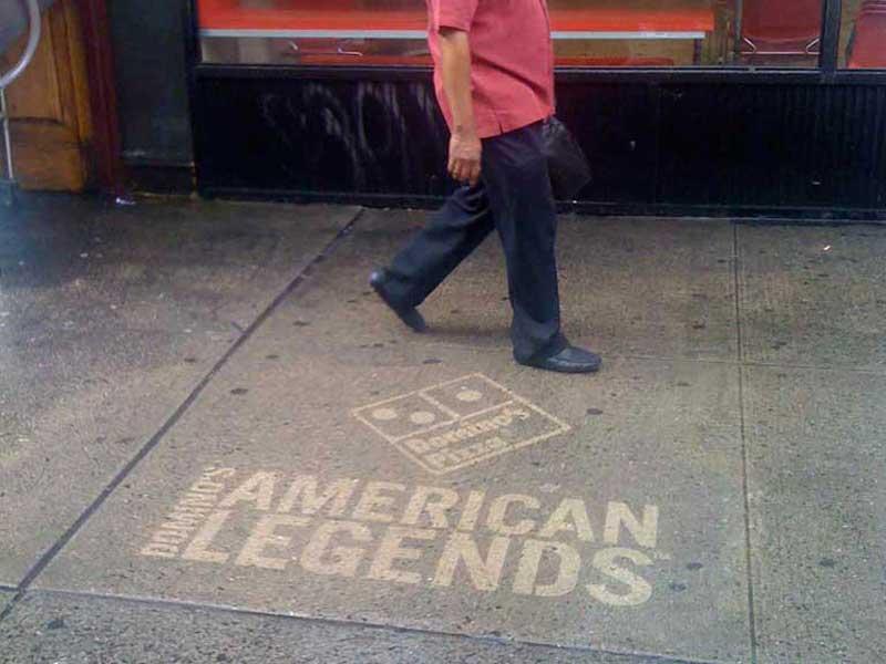 Dominos-pizza-reverse-graffiti-cleaned-advertising-sidealks-new-york-city.jpg