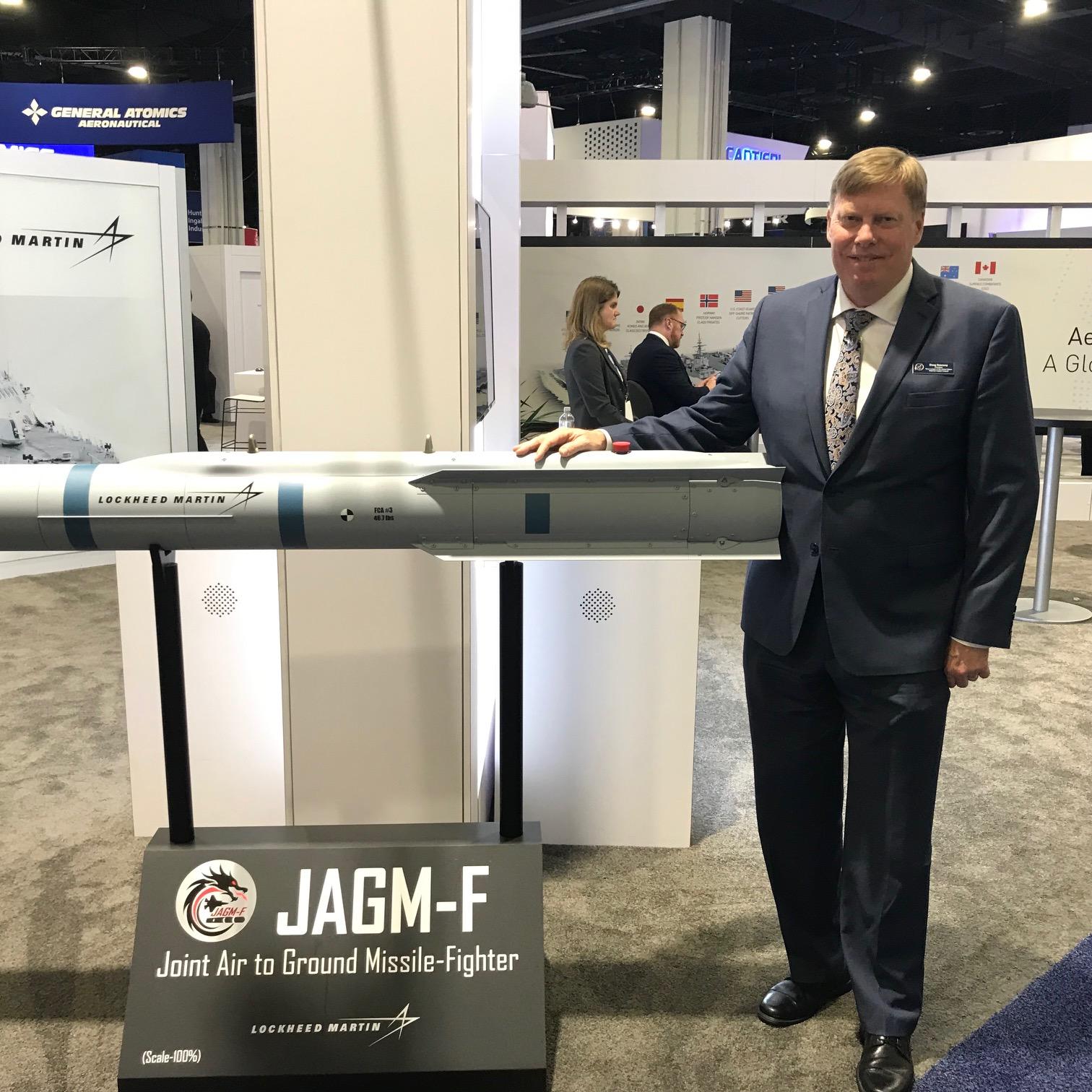 CoAspire CEO Doug Denneny with Lockheed Martin's JAGM-F Missile