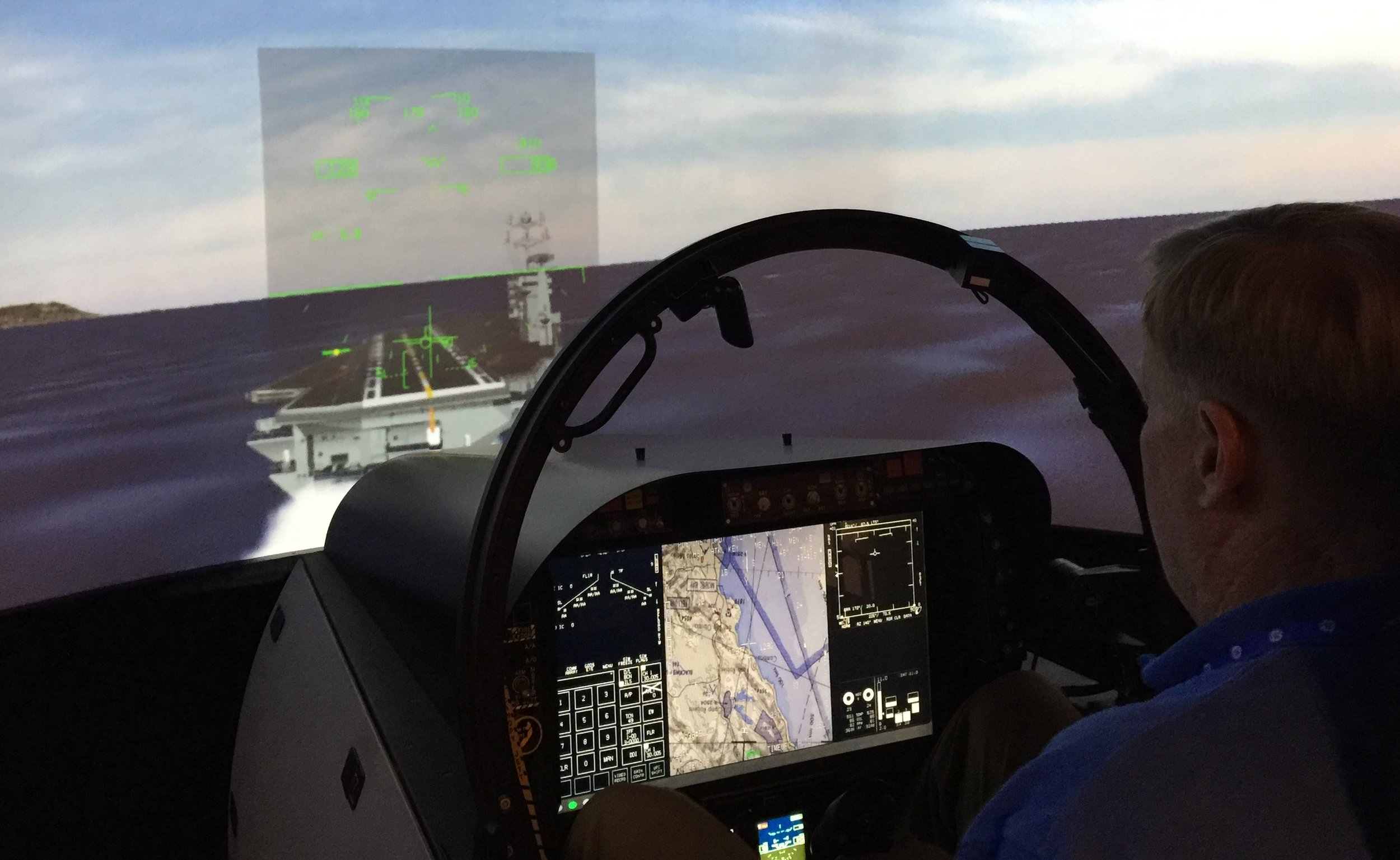 CoAspire's CEO and Founder Doug Denneny at TAILHOOK 2019 flying an F/A-18F Super Hornet aboard the carrier. Case 1 straight in, wind down the angle, stable deck, great HUD, no excuses not to have a center ball!