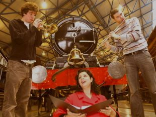 York Press, singing under a train at the National Railway Museum