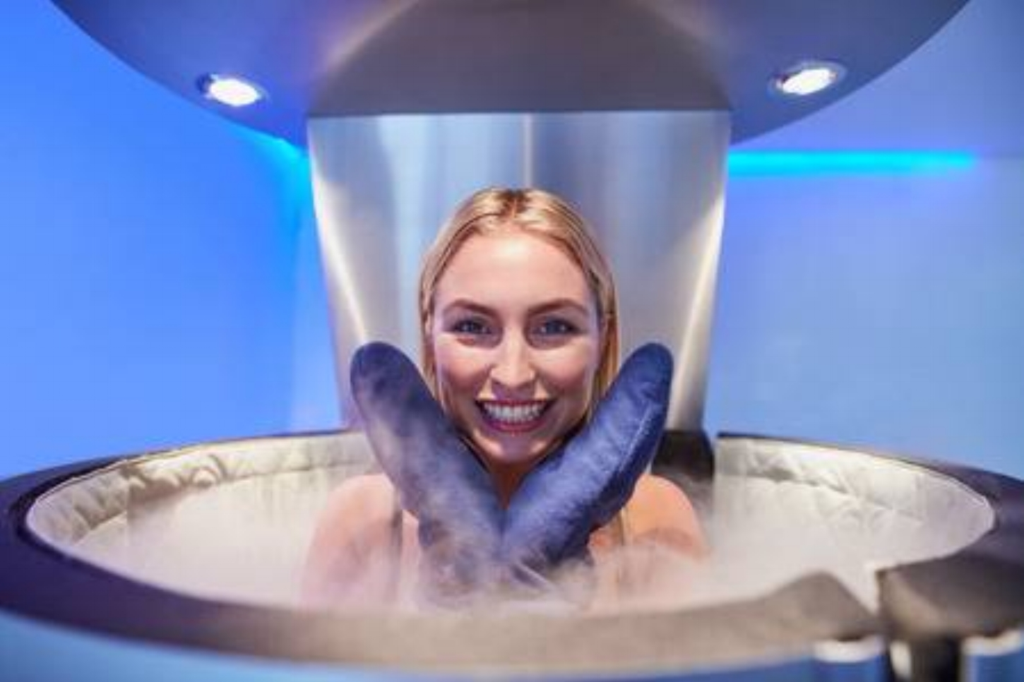 56096823-portrait-of-a-cute-young-woman-in-cryosauna-booth-for-full-body-cryotherapy-caucasian-female-in-free[1].jpg