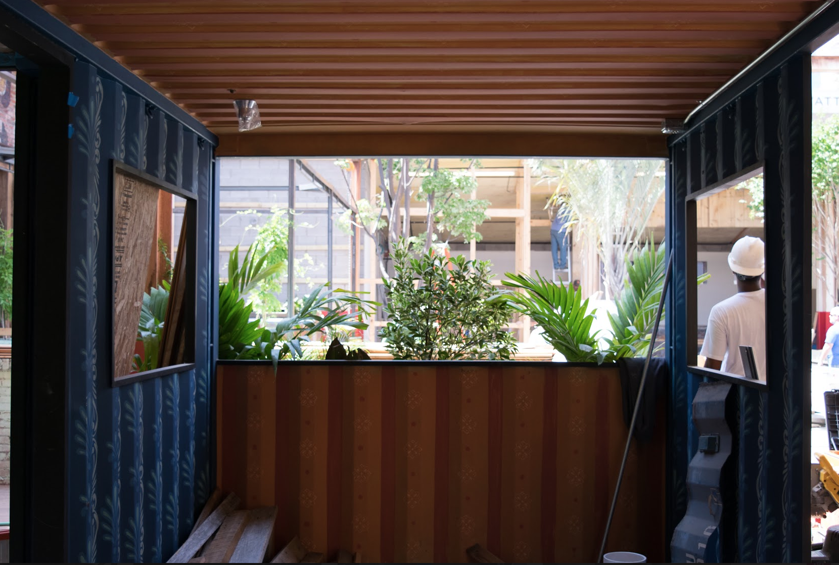 These shipping containers will be filled with furniture for a cozy spot to drink a beer (or five)