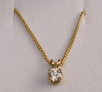 diamond-pendant-claw-set-yellow-gold.jpg