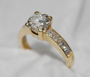 solitaire-diamond-ring-with-diamond-shoulders-yellow-gold.jpg