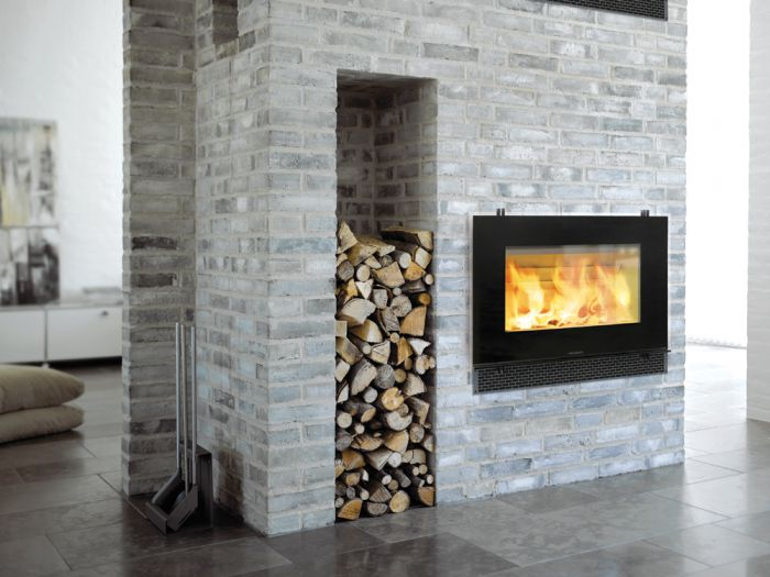 Hwam   Like a picture of dancing flames on a wall, this little stove radiates cosiness and warmth into your home...  The wide glass pane elegantly and discreetly creates a frame for the flames.   Design-consciousdown to the smallest detail withample space for big logs.