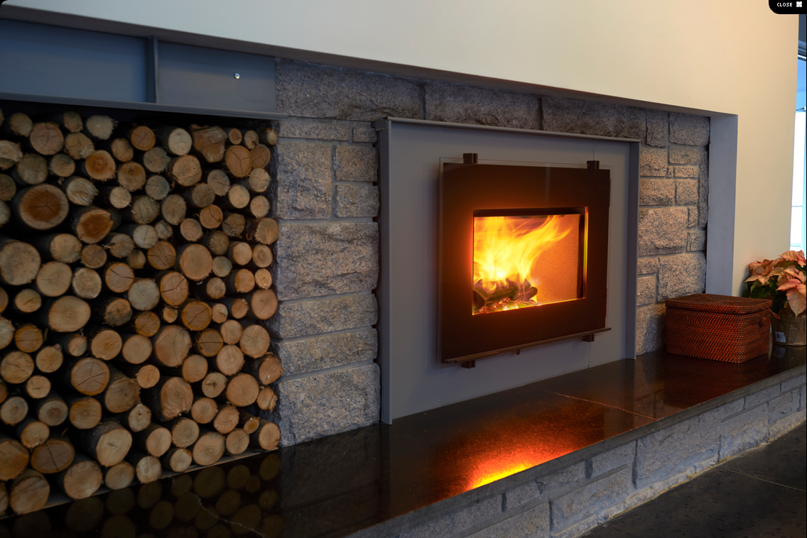 Hwam   Like a picture of dancing flames on a wall, this little stove radiates cosiness and warmth into your home...   The wide glass pane elegantly and discreetly creates a frame for the flames.   Design-conscious down to the smallest detail with ample space for big logs.