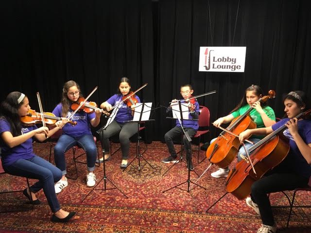 ELM Stringed instruments music studernt perform  at Marin IJ Lobby Lounge