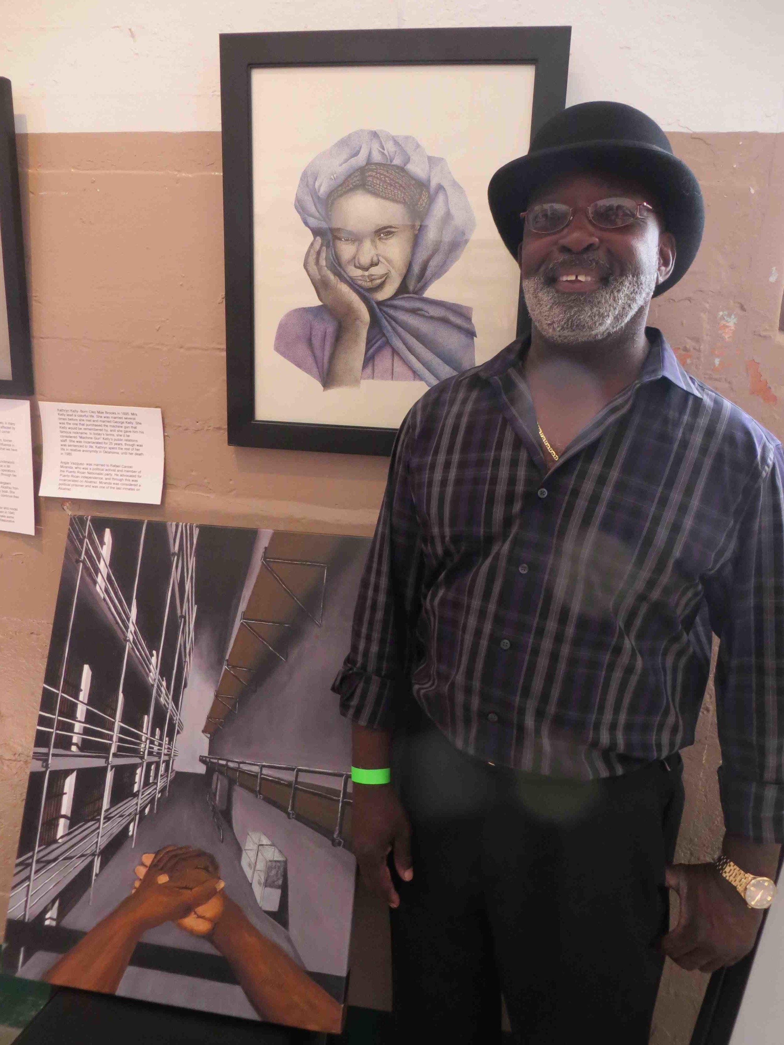 Isiah Daniels in front of his artwork at Alcatraz-006.jpg