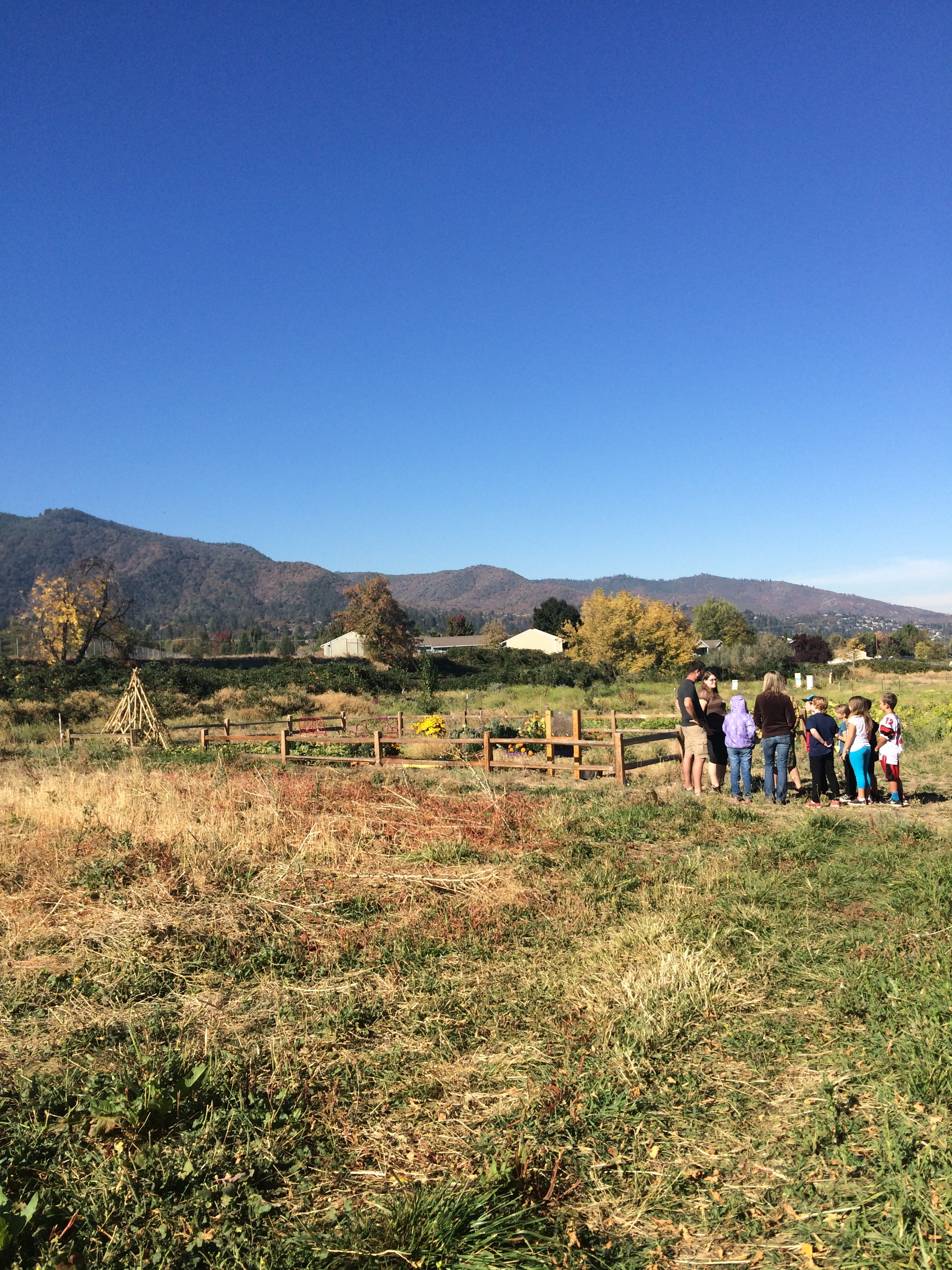 Students get instructions before exploring things to gather on the farm